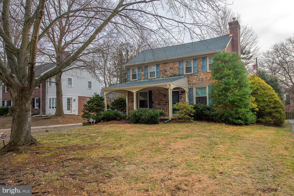 Classic center hall colonial in a beautiful Wynnewood neighborhood!   Spacious living room with gas fireplace plus dining room with chair rail.  Eat-in kitchen plus butler's pantry and powder room - all on main level.  Upstairs find the large primary bedroom with ensuite bath, plus two additional bedrooms and hall bath.  Finished basement offers plenty of options with space for an office, home gym, or playroom.  Two-car garage.  New roof (2020). Solar panels keep the electric and hot water bills low.  Lovely walkable neighborhood; close to schools and commuting routes.  A quick drive to University City and the Philadelphia International Airport.  Don't miss this one!