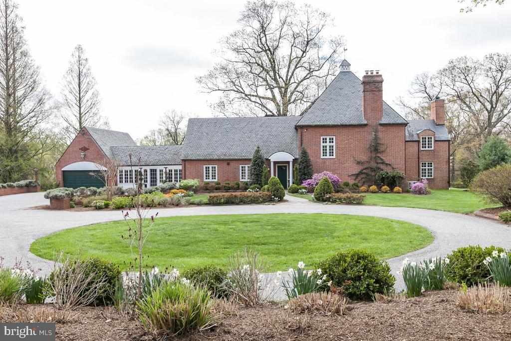 Nestled in the scenic and convenient suburb of the Greenspring Valley, this charming property was designed by renowned architect E. H.  Glidden, Jr.  Built in 1948; this property exhibits the quality of a bygone era and reminiscent of an English Cotswold Country Manor with an ideal combination of comfort and relaxed elegance. A newer  large addition makes it  the perfect combination of old word craftsmanship and thoughtful design for comfort and relaxed elegance. Recent renovations of a newer custom quartz kitchen, added wood flooring, updated or newer baths, finished lower level, updated water systems, copper quitters, upgrading of windows, etc. add to the features that today's buyers are searching for. The park-like grounds feature an expansive lawn, mature specimens trees, shrubbery and large Circular driveway and parking courtyard with 2+ car attached garage. This property enjoys privacy and a great location within minutes to everything including Wegmans, shopping, 695 & 795.