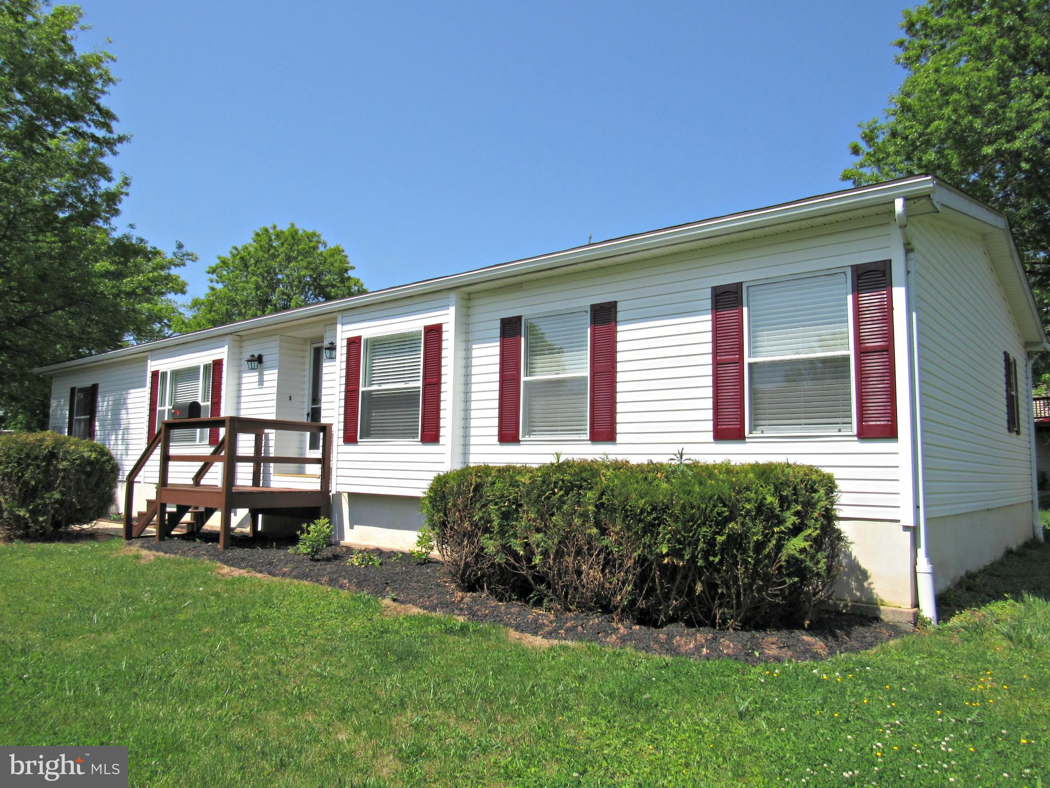 What an opportunity in Red Hill Estates 55+ community.  This home is in move in condition with new carpet and paint.  The master bedroom suite has walk-in closet and gorgeous new master bath with large shower.  Great open floor plan with a great room that offers breakfast area, living room and dining room w/extra sink and cabinetry for entertaining.  Very spacious kitchen with plenty of cabinets.  Laundry room with washer and dryer included. The property is on of the larger lots in the community.  Close to Montgomery Parks and trails.  Lot rent is $610 per month.