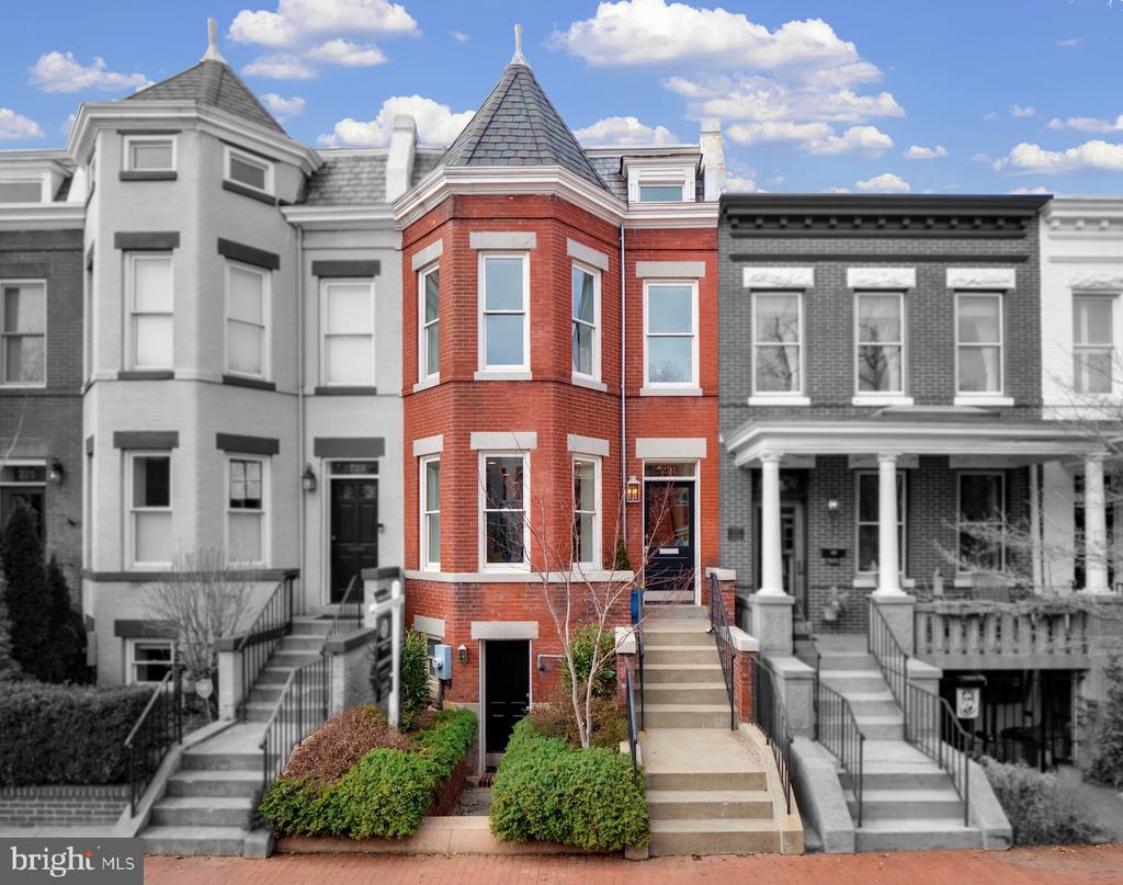 Polished to perfection, filled with light and ideally located between Lincoln Park and Eastern Market! The recent top-to-bottom renovation of this commanding brick bay-front townhome on Capitol Hill is certain to please the most discerning home seekers.  Expect premium finishes throughout the house – marble counters, designer light fixtures and premium appliances.  The open floor plan on the main living level is just what the doctor ordered, featuring glimmering light oak floors, tall ceilings and plenty of natural light.  Beyond the living & dining rooms you'll find a spacious & bright eat-in kitchen with a sitting room and access to the delightful rear patio and 2 car off-street parking!  Upstairs, the primary bedroom suite includes a walk-in closet and dual vanity en-suite bathroom.  Two additional bedrooms, a full hall bathroom and laundry complete the upper level.  The lower level is reached by an interior stairway and features its own front and rear entrances.  Here you'll find a large family room with wet bar, an open study area, a 4th bedroom and full bathroom.  The attic holds ample storage space.  Traditional meets modern with dazzling results!  View 3D Tour here: https://my.matterport.com/show/?m=efXcyY2EfJw