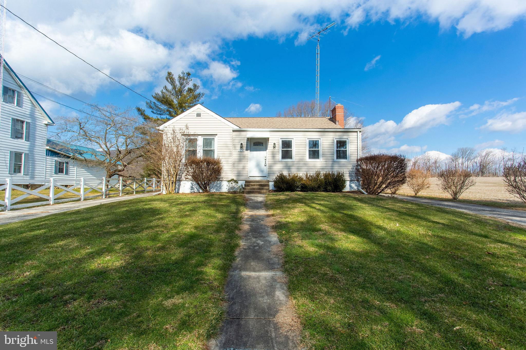 Adorable cottage in the Middletown Valley with gorgeous mountain views! Situated on almost half an acre, this detached home with four bedrooms and one bath, boasts a large eat-in kitchen, living room with vaulted ceilings, and a separate den-space for virtual learning or working from home. One level living plus an enclosed three season porch perfect as a mud room. Enjoy your private views on the deck off the living room. Upgrades include a new heat pump in 2020 and a new roof in 2017. Everything and more in the Middletown school district!