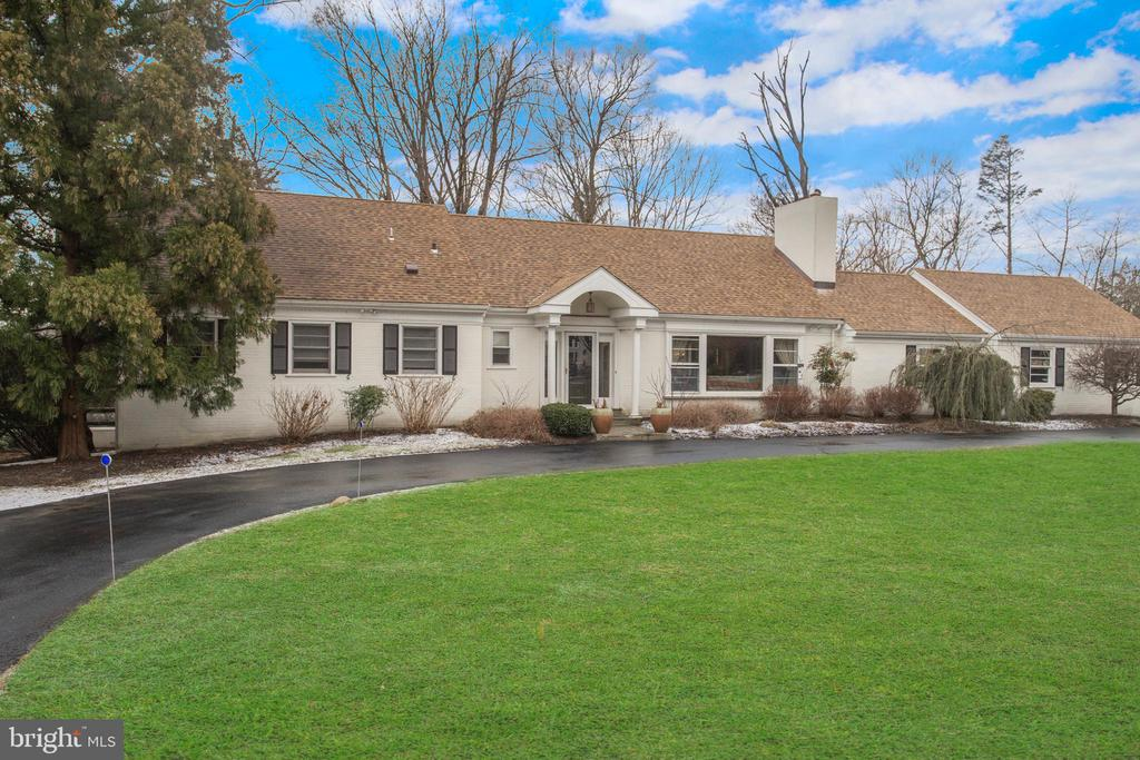 Welcome to the secluded Mount Moro Road in the stunning community of Villanova! Possessing over 3,000 sq.ft, this 4 Bed 4.5 Bath single family cape will not disappoint! Greeted by a circular driveway into a spacious two-car garage with added overhead storage. Enter through the front foyer into a spacious living room with large bay windows overlooking a lush front yard coupled with a charming double-sided fireplace shared with what could be a den/office or extension of the family room. The primary bedroom is found on the first floor with a large bathroom featuring a soaking tub, double vanity, stand up shower, and gorgeous tiling. Cook to your heart's content in this updated stainless steel kitchen with an island and breakfast bar leading directly onto a beautiful and expansive back deck perfect for entertaining all your friends and family. Two bedrooms are located upstairs and plenty of built-in storage can be found throughout the home! The finished basement offers even more storage and is perfect for another family room, gym, office, or fun work/play space for anyone in the family! Don't miss out on your little piece of Villanova and schedule a showing today