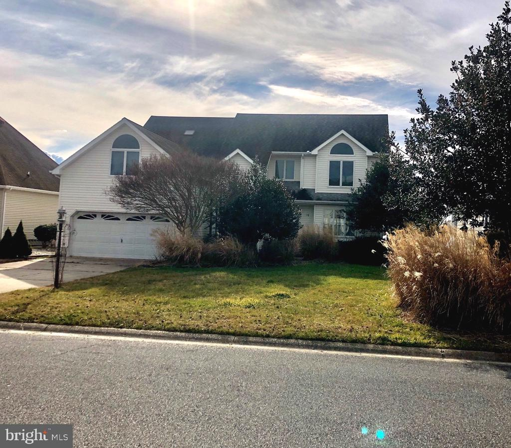 """Spacious waterfront home in Terns Landing needing a little sprucing up and TLC being sold """"AS IS""""."""