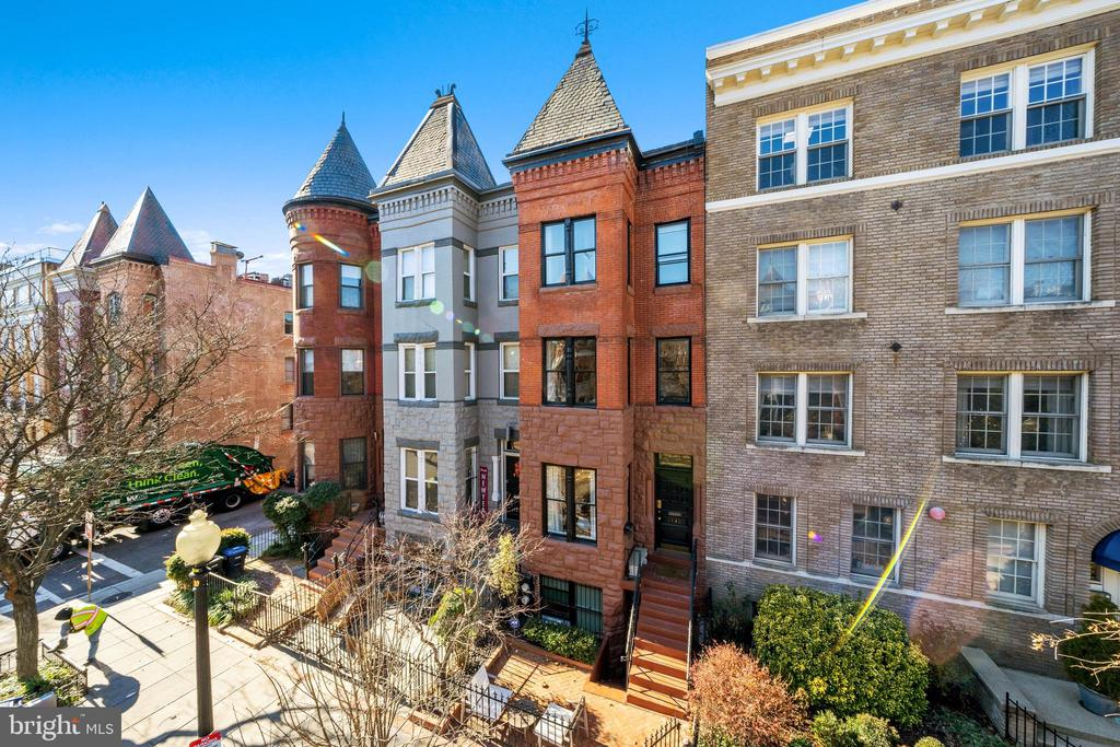 Beautifully renovated and light filled, this 4 bedroom, 3 bath townhouse is in the heart of Dupont Circle. The main level features an open living room with a fireplace and dining area, renovated gourmet eat-in kitchen with an oversized island including Wolf range, Subzero refrigerator, a built-in wine refrigerator, and access to a walk out rear deck. The second level includes a generous family room, updated bath and a sizable bedroom. The upper level has a dramatic skylight at the landing, large primary bedroom with built in closet area, renovated bath with large skylight, and an additional bedroom. The lower level apartment has a separate entrance and includes a living room, kitchen, bathroom and bedroom and has rented for $2,300 a month. Rental parking available.