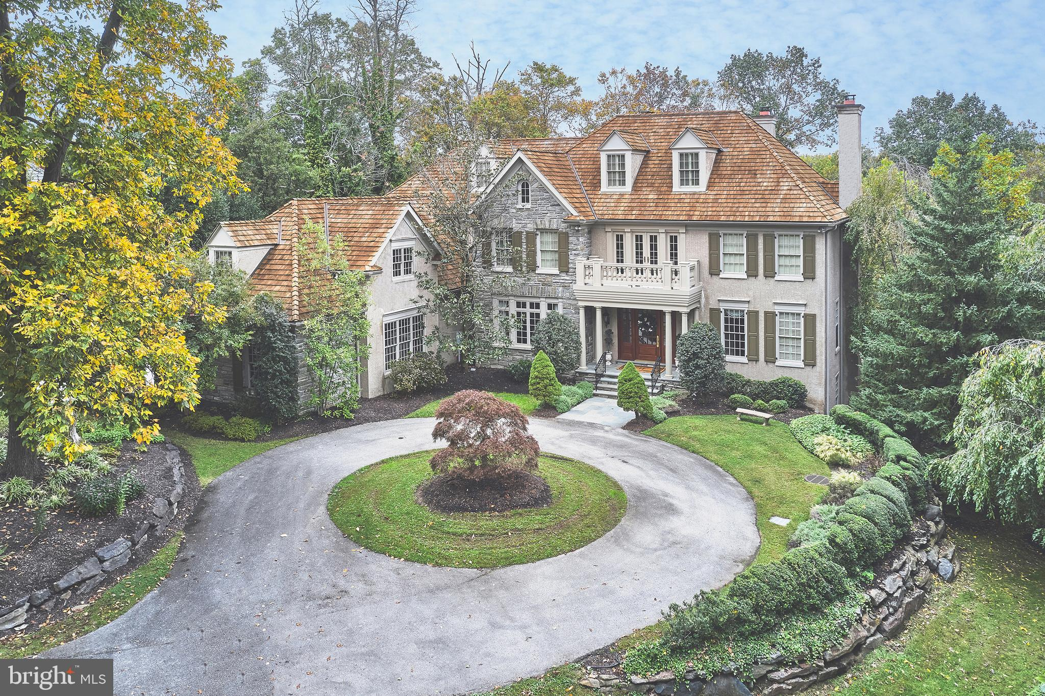 Incredible property in RADNOR TOWNSHIP!  Look no further and move right into this majestically set sun-filled manor home in the prestigious cul-de-sac neighborhood of Montparnasse, featuring superior Cas Halloway construction with every conceivable amenity, breathtaking mature landscaping, serene pool and spa, expansive private terraces, patios and views, two screened porches and more. Live every day like you're on vacation with complete privacy in this quiet cul-de-sac neighborhood, yet close to all major commuting routes, renowned schools, shopping, restaurants and more. Enjoy the gracious open floor plan offering soaring ceilings with freshly painted neutral decor, finely crafted moldings and casements, stunning cherry floors throughout much of the home, timeless finishes, a wonderful flow for every day living and easy entertaining as well as multiple office spaces and recreational rooms for the family and guests. Incredible features include 6 spacious bedroom suites each with their own custom tiled creamy tiled bathroom, frameless glass showers, a luxurious master suite with large sitting room featuring Stark Carpeting and a gas fireplace, walk-in dressing room with custom built-ins and a beautiful marble master bath with gracious decor, Living and Dining rooms with 10' ceilings and floor to ceiling windows, expansive gourmet kitchen with creamy custom cabinetry, classic granite countertops, Viking gas cooktop, two Viking wall ovens, 48' wide Sub-zero refrigerator with side by side freezer, 2 warming drawers, 2 microwaves, 2 dishwashers, Jennair grill, spacious breakfast room, step down  family room featuring a stunning coffered ceiling and endless views of the professionally landscaped grounds and inviting pool/ spa, conveniently located tumbled marble mudroom with custom built-ins and a white farm sink and access to the oversized 4-car garage, incredible finished lower level with game room, gym, movie theater room and entertaining bar as well as a bonus room a
