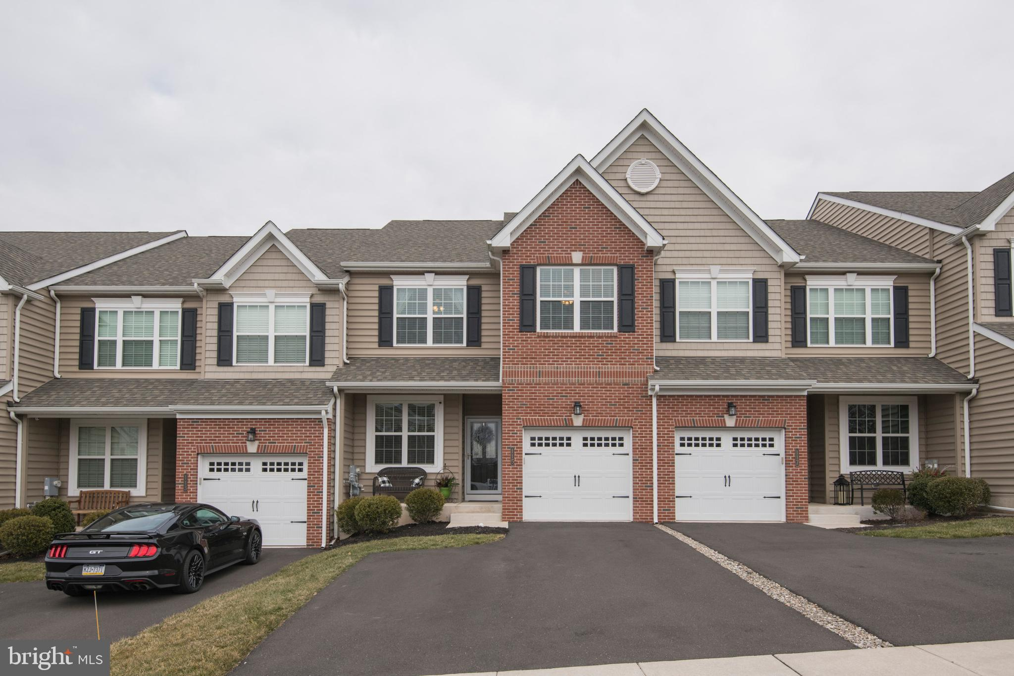 Looking for that one property that is move-in ready that offers you immediate joy and comfort? This attractive and meticulously maintained townhouse is only 4-years old and is a prized find. Act now to be the next owner of this spacious 2,500+ sq ft property with newer amenities and 9 ft ceilings on both floors. Plus, it features lots of todays in demand space including a first-floor study that offers a quiet area for working from home or virtual studies, an owners suite with dressing area, walk in closet and private bath, a partially finished basement, and a 12 ft x 12 ft deck perfect for relaxing and entertaining. From the moment you arrive you will be charmed by the curb appeal with covered front porch. The interior only gets better! Enter into the front entry foyer that gives access to the garage, study with French doors, coat closet, and powder room with pedestal sink and glass tile. The open concept floor plan offers a spacious kitchen with island featuring pendant lighting and extra seating, pantry, recessed lighting, granite counters, Travertine tile backsplash, gas cooking, and hardwood flooring. It is open to both the dining area and family room that is warmed by the stacked stone fireplace. The second floor is sure to please with convenient laundry room, owners suite with cathedral ceiling and recessed lighting, an owners bath with double bowl vanity, stall shower with seat, separate dressing area, and a large walk-in closet.  The two guest bedrooms with ample closets have access to the ceramic tile hall bath. One bedroom offers a 3 ft bump out that was only available in this Standbridge Elite Plan. The finished basement with egress window offers additional living and entertainment space. You will also get a high-efficiency gas heating system, sprinkler system, 200-amp electrical service, and so much more.