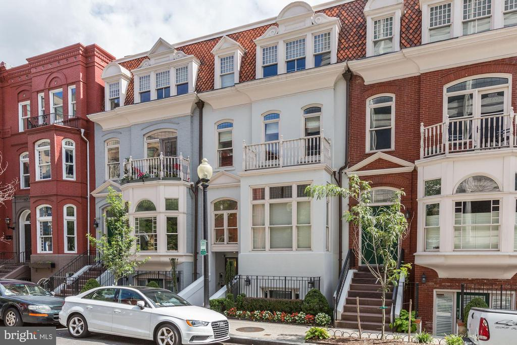 Stunning 2BR/2.5BA home in Dupont Circle. Soaring high ceilings, gleaming HWFs, high-end finishes, detailed moldings & floods of natural light throughout this home! Kit. fts. Professional Viking SS-applis., ample cabinet space, granite countertops, peninsula w/ counter seating & designated dining area. Spacious LR fts three large windows, crown molding & decorative fireplace w/ mantle. Owner's BR suite fts large walk-in closet w/ custom shelving & en-suite BA w/ custom tile soaking tub and separate shower. 2nd BR offers luxury en-suite BA. Walkable to daily errands, fine dining, all of downtown DC & public transit!