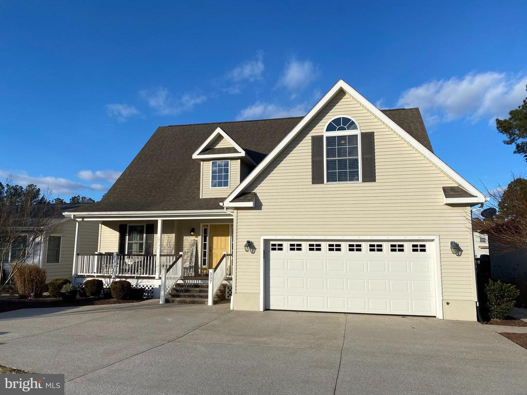 WOW! What more could you ask for in a Waterfront home? This gorgeous maintenance free 4 bedroom 3.5 bath home offers direct access to the St. Martins River. Two master bedrooms featured (one on each level) with luxury baths and customized closets. Custom kitchen features island with large butcher block top.   Stainless appliances with new refrigerator and dishwasher. Commercial Maytag washer and dryer. Designer window treatments and Hunter Douglas plantation shutters throughout. Newly renovated office/flex room with newly added side window and barn door for privacy for working remotely from home.  Additional flex room upstairs could be another office or playroom or 5th bedroom.  Professionally landscaped yard with Vinyl-tech sunroom/screen porch and oversized deck for entertaining. Large Boat dock and 8,000 lb boat lift also convey. Natural Gas Heat and fireplace. Loads of storage throughout. No detail was left out. Home was custom built by Piney Island Builders. This property has it all ! Professional interior photos coming Tuesday next week!!