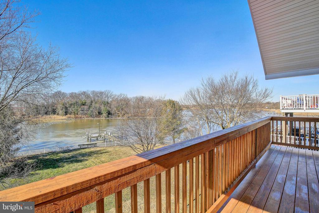 This is a Beautiful Water Front, New Construction  Home with open floor plan, spacious master suite with amazing views, gourmet kitchen and beautiful views for beautiful sunsets! Deep water on Duck Creek, across from Cox's Point Park , , !