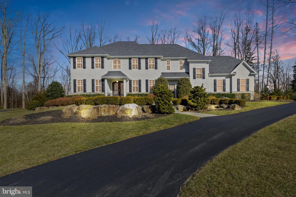 Come and enter 1304 Joy Run, an extravagant 5-bedroom, 3/2-bathroom colonial style home tucked away in a private yet conveniently located community. Enter through the beautiful double wrought-iron front doors and be welcomed by gorgeous hardwood flooring along with 10-foot high ceilings spanning the length of the entire main level. Take a seat in the charming and cozy living room/library and enjoy a cup of coffee or book during your downtime. Follow the hardwood flooring and step into the formal dining area offering plenty of space to gather around for a meal with the family. The formal dining room is highlighted by a gorgeous light fixture. Adjacent is the large and open family room complete with large windows letting in lots of natural light, a gas fireplace and surround sound theater system - perfect for entertaining guests or an immersive movie night at your disposal. Next, enter into the centerpiece of the home- the kitchen. Featuring recessed lighting, granite countertops, stainless steel appliances, a breakfast bar/island and an additional dining area by a massive window. Experience a luxury kitchen and entertain guests with ease. Also residing on the main level are two powder rooms and an incredible bonus room which can be used as an office space. The entire main first level is equipped with a Central Audio System, including 4 outdoor speakers, with individual volume controls in each room.  Head upstairs and enter into the abundantly spacious master bedroom with tray ceiling, sitting area and large, walk-in his and her closets equipped with luxurious closet systems to maximize every inch of space.  The master bathroom features a newly improved shower with 5-spray full body system and gorgeous tile flooring. The master bedroom also features a surround sound theater system, including additional central audio speakers also in the master bath.  The second level is rounded out nicely with four more sizable, fully carpeted bedrooms and two more full bathrooms. Outside, see the extensive landscaping and hardscaping complete with an outdoor propane thermocouple flame sense fire pit which can be operated via remote control.  Enjoy grilling on the spacious patio with a built-in BBQ Grill or let the kids play in the massive backyard. Overall, this home exudes a warm and peaceful atmosphere throughout the premises. Additional features include two HVAC systems, a Water Treatment system, continuous hot water system, absolutely gorgeous Plantation shutters throughout the home, nearby walking trails with streams, convenient location to major roads and the PA turnpike, and is located within the award-winning Downingtown Area School District. Come experience all these features and more yourself! Mark your calendars now and schedule a tour today!