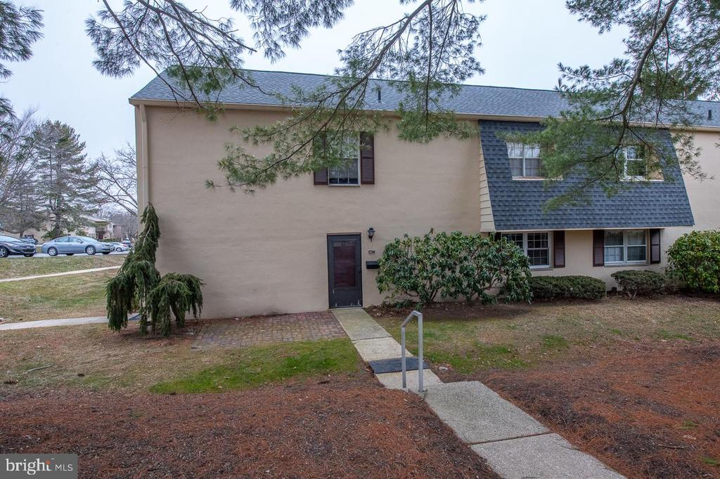 Don't miss this first floor, one bedroom and one bath beauty!  Inside you will find fresh paint, new carpet,  and a lovely updated kitchen and bath.  Enter into the foyer and then walk into the spacious living area.  The large window floods this room with light.  Move into the dining area complete with chair rail and chandelier.  Walk right into the updated kitchen with pretty white cabinets and granite counter tops.  Down the hallway you will find the updated full bath, washer and dryer area and the master bedroom.  The master is spacious, gets lots of light and has two large closets.  Outside of the unit is a pretty patio to enjoy a coffee or a meal when the weather gets warmer.  The condo fee here includes gas for cooking, hot water and the dryer.  It also includes use of the large pool area and the tennis courts.  If you like the outdoors, this community offers private access to the Chester Valley Trail.  No dogs allowed on the property, but up to two cats are fine.   All of this and a very short drive to the commuter rail, major routes, and shopping at Wegmans and Trader Joes!  Add award winning T/E Schools and you will have found a perfect place to call home!