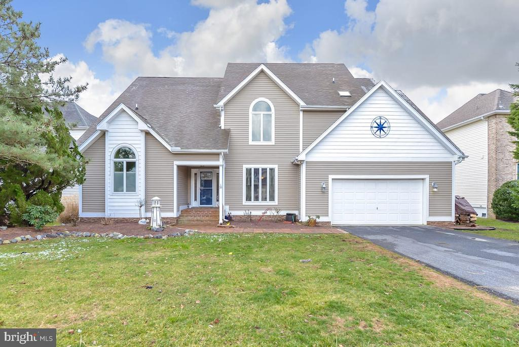 Gorgeous waterfront home in Terns Landing Community on quiet cul de sac.   Southern Exposure with Open Bay Views and Deep Water Boat Dock make this home a Special Gem.  Enjoy Gourmet Kitchen with Breakfast Area and open to Living Room with Fireplace and Cathedral Ceilings plus additional family room for entertaining - all offering a wall of sliders to the Large Deck and Yard overlooking the water.  Also, Ground Floor Master with En Suite.  Second Master Suite with Balcony on 2nd level plus 2 large bedrooms and additional Family Room.  Third Level has massive gameroom area for entertaining and a 5th Bedroom.  The Large Yard can accommodate a private pool.  The Waterfront also has 2 jet ski lifts.   Buyer may opt for $35-$40k summer rentals or cancel and move in!  Don't miss this amazing location in the Amenity Filled Ocean Pines Community with Yacht Club, Pools, Beach Club at 45th St in OC,