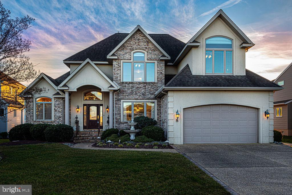 Waterfront home with beautiful curb appeal, located in Ocean Pines most prestigious neighborhood. First time offered by original owners. Home is gently used, and was custom designed and quality built.  Home features an open floorplan,  spacious 1st floor master suite, large deck, three season room and 2nd floor deck. There is a boat dock with boat lift for direct and quick access to the bay. The first floor features an open kitchen with center island and granite counters, and plenty of windows to take advantage of the water views and natural light. Every bedroom connects directly to a bathroom and features walk in closets. Additional details include hardwood flooring, gas fireplace, Andersen windows & doors, 3 linen closets and large laundry room with sink. 2nd floor heat pump is only 2 years old. Beautifully landscaped with lawn irrigation. Enjoy all the community of Ocean Pines has to offer including Yacht Club and restaurant, 5 swimming pools (1 enclosed), Robert Trent Jones golf course, marina, community center, beach club, skate park, dog park, community police and fire departments. Playgrounds and athletic fields.