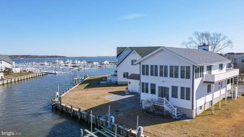 Unique Ocean Pines waterfront home located in the serene section of Pintail Isle. This home features 4 bedrooms, 2 bathrooms, and a master suite with spectacular water views. Stretch out on a half acre lot located at the end of the cul-de-sac. Admire the panoramic views of Ocean Pines and Ocean City. Approximately 150 feet of bulkhead, private dock with boat and jet ski lift for quick and direct access to the bay.