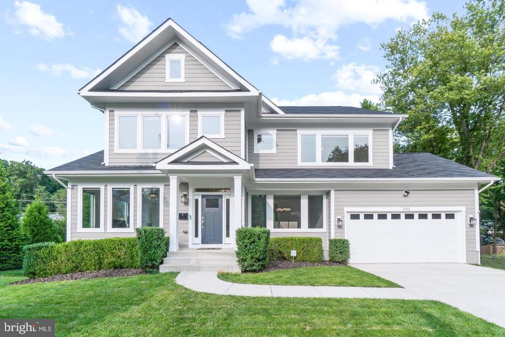 Very spacious 4-level custom home on a beautiful and quiet street in the Town of Vienna. Open and sunny layout with floor-to-ceiling windows overlooking a beautiful backyard, like something out of Architectural Digest. Absolutely breathtaking! All other windows in the home were upgraded to European-style casement windows to maximize light and energy efficiency. Recently remodeled and renovated, freshly painted interior and exterior. You will love the four spacious, upper-level bedrooms. The master and two additional bedrooms on the second level each have en suite bathrooms. And you can hide away in the fun, loft-level bedroom with walk-in closet and full bath! A 6th finished bedroom added in lower level. Your kids and guests will appreciate the space and privacy. Large main-level room can be used as a living room, office or bedroom with en suite full bath. In addition to all the extra space, this home features beautiful luxury finishes throughout: stainless-steel appliances and granite counters in the kitchen, upgraded tiles and fixtures in all bathrooms, hardwood floors, recessed lights and so much more. Very spacious walk-out, lower-level Recreation room has a half bath (with rough-in to be a full bath) . Features a whole home water filtration system as well as a whole home gas generator for power outages. This home is situated on a large, flat corner lot (1/3 acre) that offers privacy, room for a garden, a patio, sidewalks and mature trees. Easy commute to Vienna Metro (1.3 miles), Dunn Loring Metro (2 miles), downtown Vienna, Tyson's, Merrifield, 1.4 miles to W&OD bike trail. Enjoy Vienna living at its best!