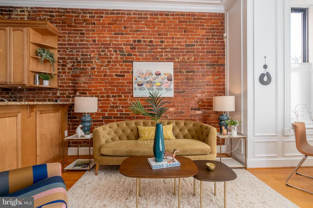 Bloomingdale Charmer! This 2 bed, 2 bath condo has it all, including reserved parking and a large deck! The unit features hardwood floors throughout, exposed brick, and crown moulding that draws the eye to the high ceilings. With light streaming in from the south-facing front bay windows, the open living area leads to a large kitchen with stainless steel appliances, granite countertops and a breakfast bar. The primary suite features an ensuite bath with dual vanities and a separate jacuzzi tub and shower. The second bedroom can double as a home office or a guest bedroom and features a custom-organized walk in closet and direct access to the second full bath. There is a large deck at the rear of the home, perfect for relaxing outdoors or having socially-distant get-togethers. The property is rounded out with a reserved parking space and in-unit washer/dryer.   The boutique, pet friendly three-unit building is perfectly placed in the heart of Bloomingdale with staples like Red Hen, Big Bear, and The Pub & The People just around the corner. With a WalkScore of 93, it offers easy access to everything you need. The Shaw/Howard Metro is just a couple blocks away down Rhode Island if you want to leave your car parked at home! Square footage is estimated per professional measurements. Offers requested by Tues 2/16.