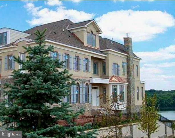 THIS IS NOT TO BE MISSED! With SPECTACULAR VIEWS of the Potomac River and Championship River Creek Golf Course (18th Hole), this Rarely Available - End-Unit Townhome is like No Other! Beautifully re-designed and updated, this fabulous 4 level property offers custom designer upgrades throughout, complimented by distinctive features and elegant architectural details that you expect in a luxury home. Indulge yourself in one of the most beautiful and sought-after resort-like communities filled with amenities from the state of the art golf course to three swimming pools, newly renovated fitness center, tennis courts, kayak launch area, walking trails, and a clubhouse ready to meet your dining needs!