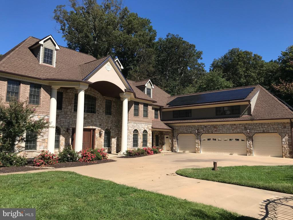 JUST LISTED! - COMING SOON! -  Luxury Estate Home with Over 11,000 Square Feet on 5 Acres in Clifton!  Open Floor Plan with 4 Levels, 6 Bedrooms, 7 Baths and a 4-Car Garage!  This Home is the Ultimate in Private Living, Far Away from All of the Noise, Traffic and Hustle Bustle of Crowded Areas, Yet it is Close to  Shopping, Schools, Recreation, Parks, Major Highways and  More Rural Areas.   Lots of Large Windows and a Southern Exposure Make  the Home  Bright and Inviting!   Gorgeous Views in a Park-like Setting and Abundant Wildlife MakeYou Feel Alive and at One with Nature.  Great Schools and Sports Activities for Growing Children and Families.   This Home Sits on One of the Best Lots in All of Clifton that Provides so much Versatility!  Gated Front Entrance with Remote Controls for 2 Gates - 2016 - 8 Access Gates - Landscape Lighting in Front and Back, Electricity Throughout the 5 Acres as well as being Completely Fenced.  Open Grounds with Groomed Treed Areas - Crepe Myrtles Line the Front of Property.   1/8 Acre Garden in Backyard with 10' Tall Chain Link Fence with Double Gate - Fruit Trees (Apple, Peach, Cherry, Pear, Nectarine)  -  3-Stall Barn with Concrete Floor and Hayloft - Riding Ring which could be Converted  to a Sports/Tennis Court!   New In-Ground Pool and Deck - 2019 -  Salt Pool is Heated with Lights and Remote Control - Wiring for Hot Tub on Pool Deck - Multiple Decks!  -  Outdoor Shower.  Hybrid Solar System - 96 Panels with Battery Storage and Backup Generator with 1,000 Gallon Propane Tank - Sells Back Electricity to NOVEC, Provides Off-Grid Power, Ability to Load Manage within the House and Provides Power to your Electric Car in a Lights Out Situation - 2018.  4-Stop, 2 Door Elevator - 3 Laundry Rooms -  4 Master Bedrooms - Oversized 4-Car, Drive -Through Garage!   95% Stone and Brick Exterior - Remaining is Hardy Board Siding. Energy Efficient Windows and Doors - 3 HVAC Systems, Including 1 Geothermal System! - Soaring Cathedral or Vaulted Ceilings Throughout - Upgraded Trim, Recessed Lighting and Cove Lighting in Recessed Ceilings - Oversized Interior Doors (8' x 3') and Wide Hallways - Sound Insulation Between Walls of Bedrooms, Bathrooms and Select Floors with Insulated (Solid) Doors.  Exercise Room and Game Room - Built-in Bar with Sink/Plumbing/TV Near Pool!  2 Woodburning Fireplaces!   Private Secluded Dream Home Less than 30 Minutes from Tysons,  Herndon, Chantilly,  Springfield, Ft Belvoir or Quantico!