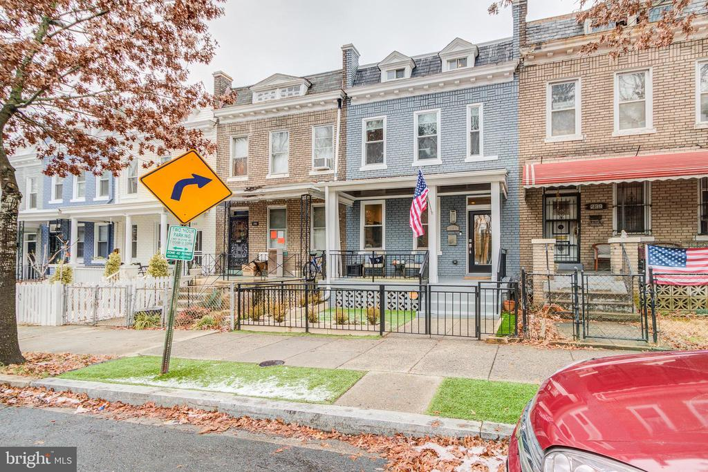 Stunning home in Petworth. Renovated from top to bottom in 2016, and improved by the owners since then, this home has it all. Open floor plan with 4 bedrooms and 3.5 bathrooms featuring top of the line finishes. Coffered ceilings, gourmet kitchen with SS appliances and Dekton ultra composite counters, spa-like baths. Hardwood floors on two levels, tons of natural light, raised ceiling in master, built-in seating in dining area, 2nd floor washer/dryer. Fully finished basement with bedroom and bathroom as well as a kitchenette w/ sink and full refrigerator, perfect for in-laws or home office or gym. Great porch for relaxing in summer months and gazing out onto the trees and grounds of the Old Soldier's Home across the street. Off-street parking in rear. Pet-friendly and maintenance-free premium turf installed in front yard. Terrific location, walking distance to Metro, Upshur Street, Georgia Avenue and all that Petworth has to offer. This is a must see. Open Sunday 12-2pm.
