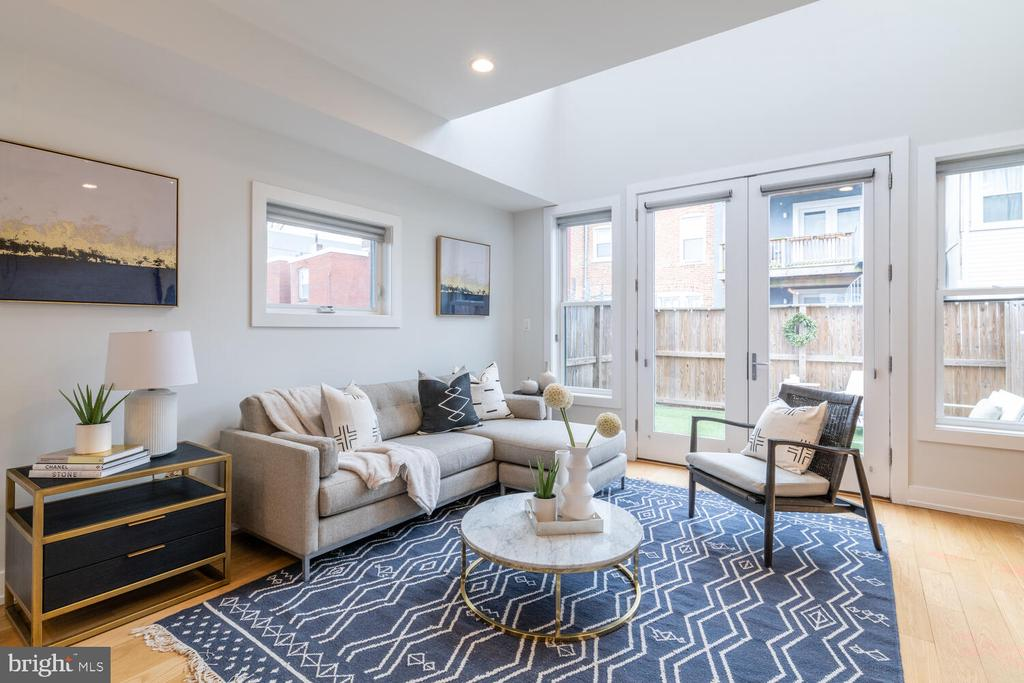 1st OPEN SUNDAY 2/14, 1-3PM! * This is a 2 bedroom + DEN / 2.5 bath home, built new from the ground up in 2016. * 628 I St NE, #3 is a truly unique property. This standalone carriage style house is part of a three unit boutique condo building yet lives like a single-family home.  Beautifully finished and boasting a contemporary vibe, this home offers a smart open concept floor plan with approximately 1,755 sq ft spanning across three floors.  As you step from your private gated parking area into the entryway, you will be greeted with a huge beautiful island that anchors the kitchen with cooking on one side and countertop seating on the other.  Two large closets under the stairs house plenty of pantry storage and a tucked away wine fridge.  The space flows naturally toward a large living area with two story ceilings and tons of sunlight. Large French doors open directly from the living area onto the perfect size outdoor space with a high privacy fence that backs to your lovely neighbors' yard.  The first upper level features a chic loft-style den that is perfect for a home office or exercise area with a smartly tucked away half bath for your guests.  The jack-and-jill style full bath which adjoins the den and full bedroom makes this space incredibly versatile. Just up the stairs, the entire top level is dedicated to an owner suite of your dreams.  An en-suite bath with double sinks, an enormous walk-in closet, and a sunny private deck make this the perfect place to begin and end your day.  Natural light floods each level of this turn-key ready home and accents the gleaming hardwood floors, high ceilings, and open floor plan with pockets of sunshine nestled throughout. This incredible H Street location is just steps from Whole Foods, Giant Grocery, Trader Joe's and the ever expanding Union Market, with all of its eclectic shops, eateries, and phenomenal restaurants. Grab a yummy pastry at The Wydown and catch up on some work in the beautiful lobby of the Apollo, then peruse the stacks at Solid State Books. Grab a salad at Farmbird or meet a friend for a special meal at Fancy Radish.  Catch a train at Union Station, or hop on the bike lane just in front of your home to zip off on an adventure. With a Walk Score of 96 and a Bike Score of 93, this is urban living at its best.