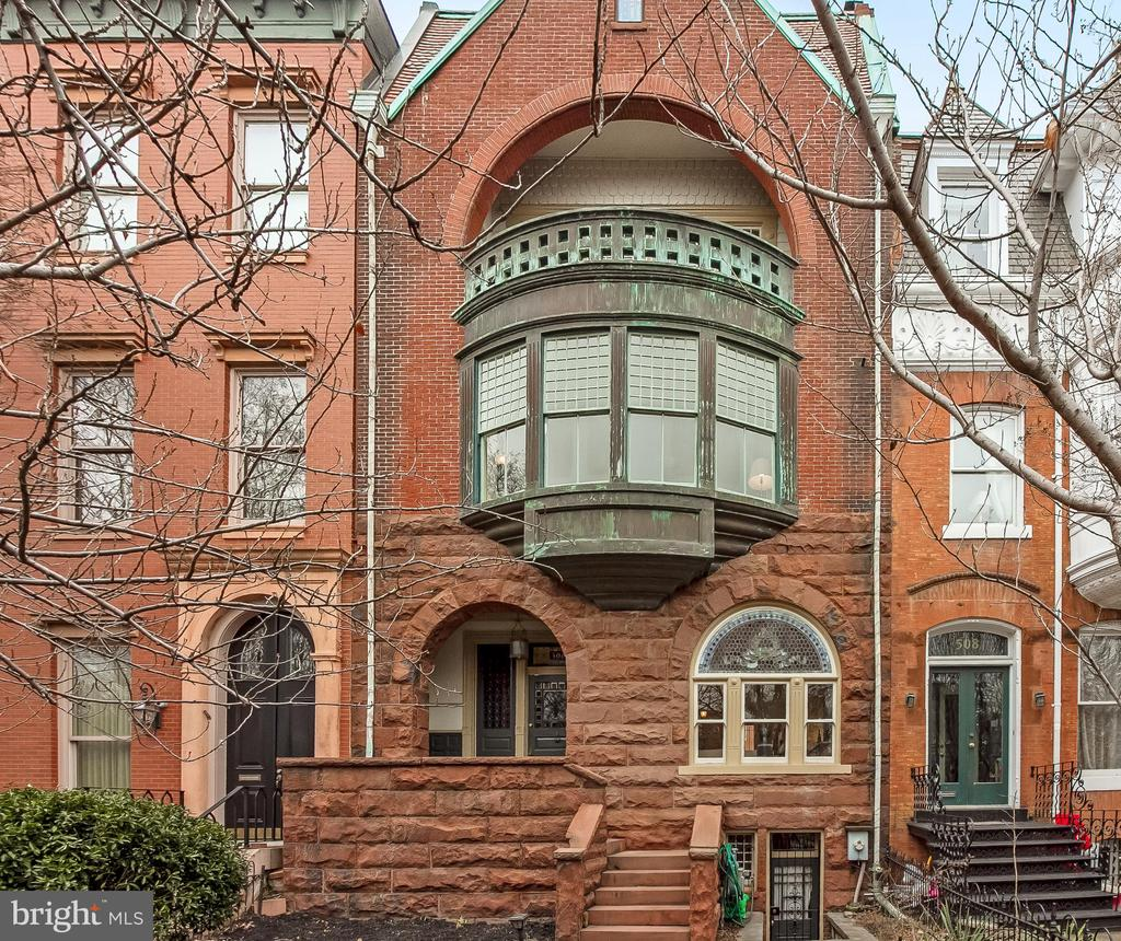 Own a piece of history!  Grand Dame on Capitol Hill's most prestigious street. The Doolittle-Tullock House is a stunning Richardsonian Victorian designed by architect Robert Stead (1887) with stained glass windows, 11 ft ceilings ,a second story corbeled bay, and a third story balcony with a view of the Capitol! It also features a fourth floor garret/artist studio, as it was once owned by the family of Lincoln Memorial sculptor Daniel Chester French. This magnificent house features 9 fireplaces, 5 bedrooms, 4 1/2 baths, dining room, library and 2 parlors. This rarely available historic stunner on East Capitol Street is featured in The Majesty of Capitol Hill (2005, pp104-109) boasting 5250 SF plus 1300SF basement (with 8 ft ceilings) and parking for 3 cars!
