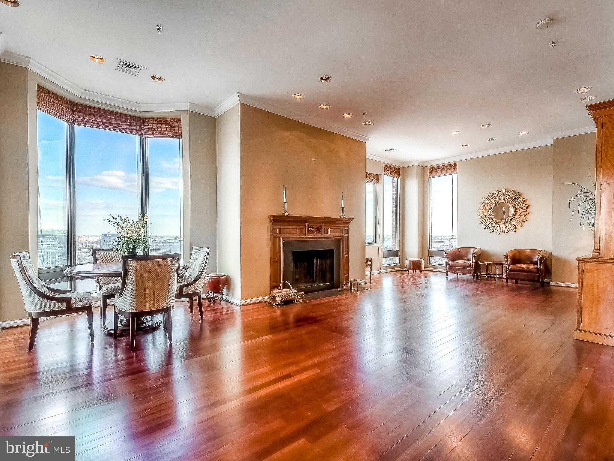3D Virtual Tour now available!  Breathtaking 28th floor penthouse in The Towers at Harbor Court. Sweeping views from floor-to-ceiling windows of Baltimore's Inner Harbor, Federal Hill, stadiums, and the city skyline. This one of a kind condominium features rich hardwood flooring, marble, a private elevator lobby, oversized master suite with a spa bath, ample closet space and beautifully crafted built-ins. A large wood-burning fireplace and incredible views of the Inner Harbor make the large main living space a show stopper. Luxury amenities include 24/7 front desk staff, concierge and porters, secured parking and shared amenities with the attached Royal Sonesta Hotel that include a guest suite, pool membership and fitness center along with restaurants and lounge.