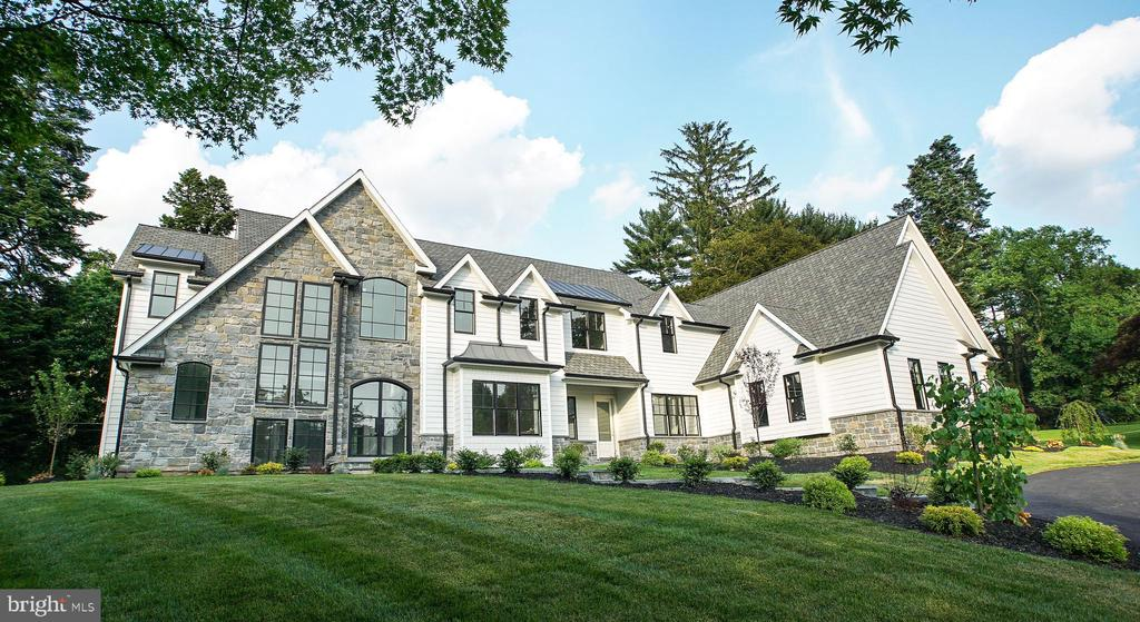 Best Of the Main Line - Radnor Township New Construction.   Masterfully built on a gorgeous one acre lot with 9300 square feet of move-in ready finished space.  This home embodies luxury at every turn.  Massive foyer featuring a custom Iron Door, Quarter Sewn White Oak flooring  with a herringbone pattern, 10  ft ceilings, and a grand staircase with an impressive wall of windows. Sprawling open floor plan.  Enormous Chef's Kitchen with Thermador appliances, Custom Craft Maid Kitchen Cabinets and impeccable Cambria Quartz countertops with Artistic tile backsplash.   Built for entertaining, the adjacent butler's kitchen features it's own double oven and dishwasher with effortless flow into the dining room.  All bedroom have en suite baths and the Master features an attached Nursery/Office /Closet that can be reverted to the 5th bedroom very easily.  The fully finished basement adds 2500 square feet of living space and features a Large gym w/ full bath and steam shower as well as a separate theatre room   Oversized 3 car garage equipped  to handle lifts for the  car enthusiast.  The backyard has a gorgeous covered slate patio and is engineered for a future pool and pool house, as well as additional hardscaping.  Located on a sought after street and close to all of the amazing dining and shopping the Main Line has to offer, this unique home will not stay on the market long.   Showings to begin on Saturday February 20th.