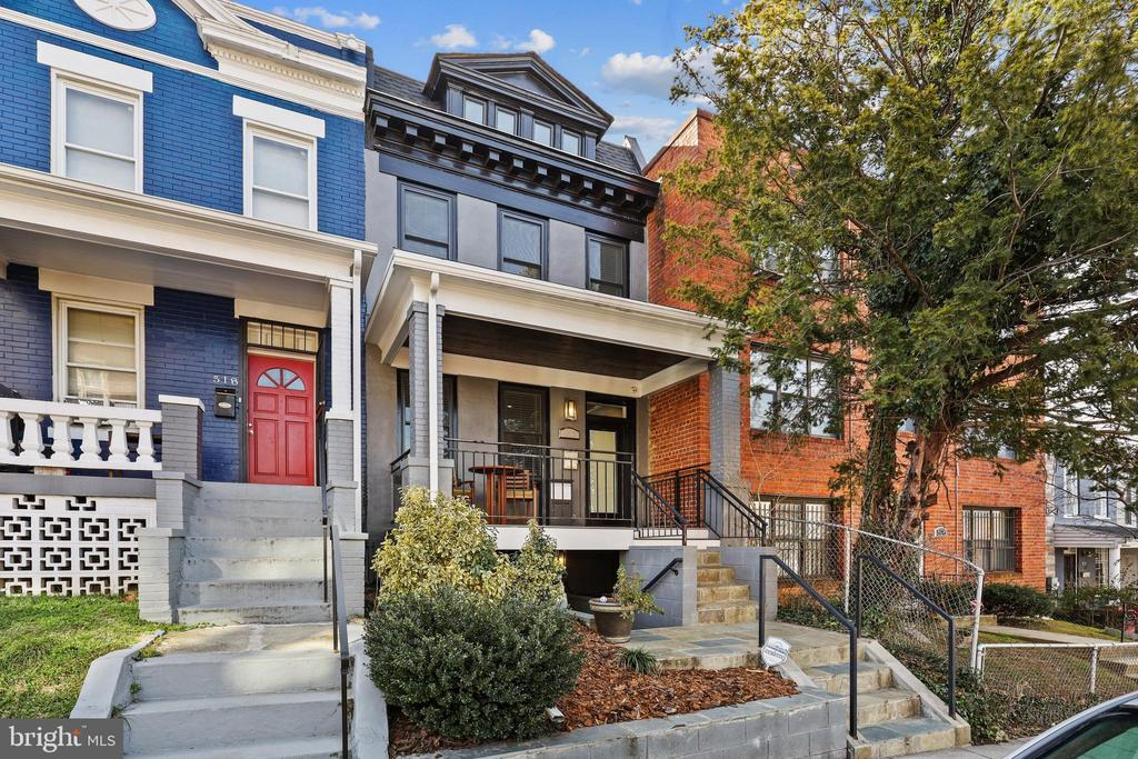 SHOWINGS AVAILABLE THROUGH MONDAY 2/22 @ 6:30pm. This is a rarely available FULL rowhome, not a split level and NO HOA. Top of the line, top to bottom renovation impeccably done by established developer & very lightly lived in by meticulous homeowners.  This is not your typical flip! 2600 square feet of carefully planned, finely finished space with an open layout that boasts timeless finishes.  Traditional front porch, that's attentively tucked in off the street, ushers you into a classically modern stunner! Luxurious living room with high coffered ceilings opens to a generously sized, elegant dining area that spills gracefully into the gourmet kitchen. Sun-filled kitchen with clean, high-end finishes such as Dekton Aura countertops, 5 burner range and a french doored fridge that with a very long list of luxurious features. Deck of the kitchen offers a fantastic spot to grill and your private backyard creates a beautiful space to safely entertain outdoors in your fully fenced, private oasis. Hardwood floors continue upstairs to a well-appointed primary suite that boasts a tremendous amount of storage space, a gorgeous spa bath with skylight, period details such as a transom, and moderns updates like recessed light. 2nd spa bath and two additional bedrooms complete the upper level. Lower level offers both a front and back entrance into an awesome, versatile space that could be used as a full in-law suite, potential rental space or the recreation room/party space you've been looking for with a full guest suite. Enclosed parking around back with parking for 2 cars, already set-up for charging an electric car.  So much already in the neighborhood. So much future promise of what's to come too. At 520 Newton, you have everything you want within your walls and need within blocks... with best-in-city restaurants and entertainment including Call Your Mother Bagels, Timber Pizza,  Sonny's, No Kisses, Hook Hall Beer Garden, Midlands, Mr. Braxton's, and many more! OFFER DEADLIN