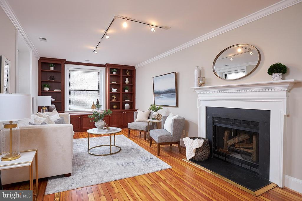 "Open Sunday 2/28, 2-4pm - A rarely available 2br/2ba stunner of a unit, located in a quintessential pre-war-beaux-arts-boutique-elevator building!! Unit 201 in the sought after ""Best Addresses"" Portsmouth is the complete package situated amongst Embassies and directly next door to The Carlyle Hotel in the HEART of Dupont. From the moment you enter the formal foyer to the unit you know you are in a special space. The antique hardwood floors have been freshly refinished and the high ceiling heights are evident. In the main living area you'll find plenty of room for both dining and entertaining as well as a wood burning fireplace. The Kitchen boasts granite,stainless, and custom cabinets for days.  The primary bedroom is LARGE (benefiting from the building bay front) and is  completed with a gorgeous updated ensuite bath. The second bedroom also offers tremendous size with large closets. There is a second full bath as well just off the foyer (and second bedroom) providing a complete separation of spaces for housemates/guests! Central Air/Heat, In unit washer/dryer, gorgeous built-ins and moldings, no detail overlooked. The building has a fabulous communal courtyard patio complete with BBQ grill, additional storage, as well as a residents loading and unloading driveway space, and walkway for access without steps! Pet Friendly and less than half a block to the S Street Dog Park. But the cherry on top of the sundae.. separately deeded GARAGE PARKING, a super valuable commodity and convenience in this incredible location. You won't need to drive much though when you are just steps from some of the BEST restaurants in DC (Anju, Pupatella), several grocers, the Dupont Farmers Market, the list goes on.. Truly a must see property!!"
