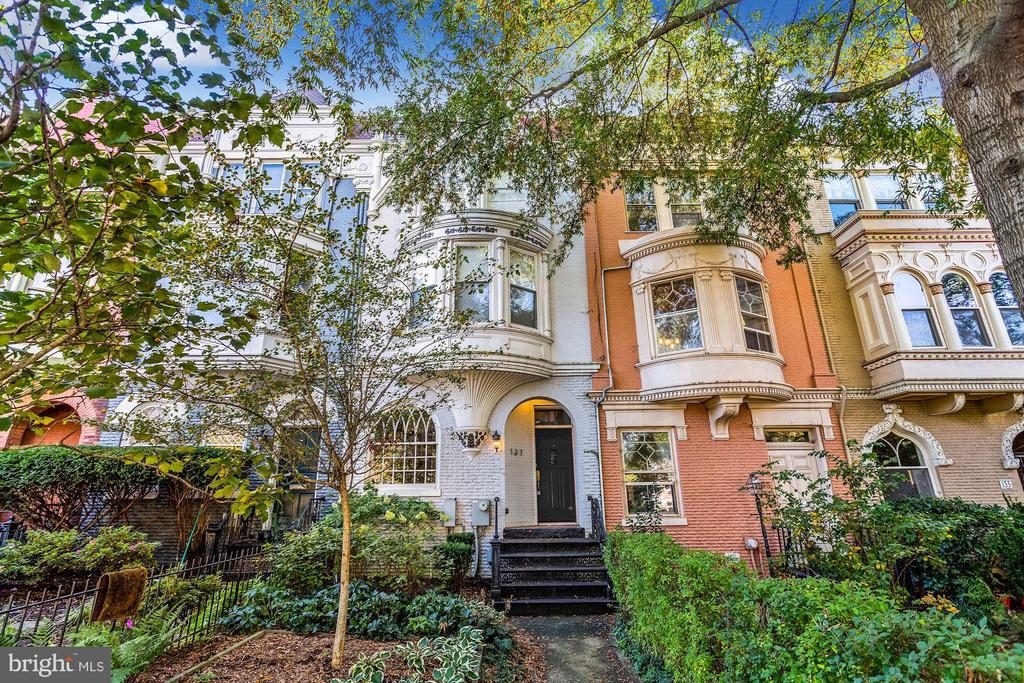 Truly special, updated historic home on one of the Hill's prettiest streets! Featuring charm, character, and beautiful details throughout while also offering  today's modern amenities, this 3BR and 3.5BA home features an open concept floor plan with 9-foot ceilings, new 5-inch wide wood flooring, and exceptional indoor and outdoor living spaces. The stunning kitchen features quartz countertops, marble herringbone backsplash, new cabinetry and opens to the dining room and great room to make for easy living and entertaining.  The Great Room offers stunning finishes, fireplace and a glass door that allows perfect flow to the outdoor space. On the upper level is an expansive owner suite, as well as the light-filled family room with another glass door leading to the upper level deck. The third level  includes two secondary bedrooms and full bathroom, and laundry room. The rear space features a fully fenced living area that with an expansive flagstone patio and upper level deck for  outdoor living opportunities to entertain and enjoy everyday life.  Complete with a two-car-parking pad with an automatic door, this home is has it all. Perfectly located just blocks from the U.S. Capitol, shops, restaurants, parks, green spaces, and more, this iconic location offers the best of historic charms plus luxurious modern amenities. Truly a special offering!
