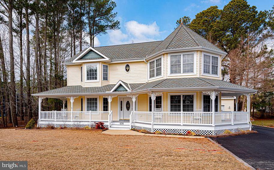 One of a Kind, beautiful custom designed home, located in one of Ocean Pines most popular neighborhoods, The Point!  This spacious home takes full advantage of outdoor living with an inviting wrap around front porch, screened porch, rear paver patio and back yard. The two car garage includes a full set of stairs leading to ample storage space (350 s.f.). You will have plenty of room for family or a home office, in this 5 bedroom home. There is a 1st floor master suite, and 4 large bedrooms on the 2nd floor. The large kitchen features solid surface counters, beautiful tile backsplash, stainless steel appliances and a counter bar. There are plenty of windows for natural sunlight. There is a fire sprinkler system installed for extra safety measures. This home offers great closet space and has a laundry room on both floors.  The ceramic tile, carpet and luxury vinyl plank flooring has been updated in the past 4 years, and the other rooms feature hardwood flooring. Very well cared for home shows pride of ownership!