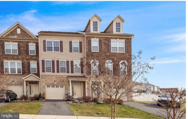 Beautiful 5 year old townhome in the highly desirable community of the Village of Bayberry in the Appoquinimink School District. This home provides beautiful views of walking trails and gorgeous scenery. A finished basement that has a bump out and can  can be used as a man cave, family room, or a home gym. The home has 3 bedrooms and 2.5 bathrooms. Upstairs there is a large living room with an eat in kitchen that has a bump out that can be used as a sun room. The kitchen boasts beautiful backsplash that gives the kitchen the look of a designer kitchen. Off the kitchen is a sliding glass door that leads to the deck overlooking the backyard. On the 3rd floor is the master bedroom with a bump out for a sitting area for watching TV or relaxation along with the the master bathroom. There are 2 additional bedrooms and a large full bathroom. Just minutes to route 1 and route 13, this home won't last long.