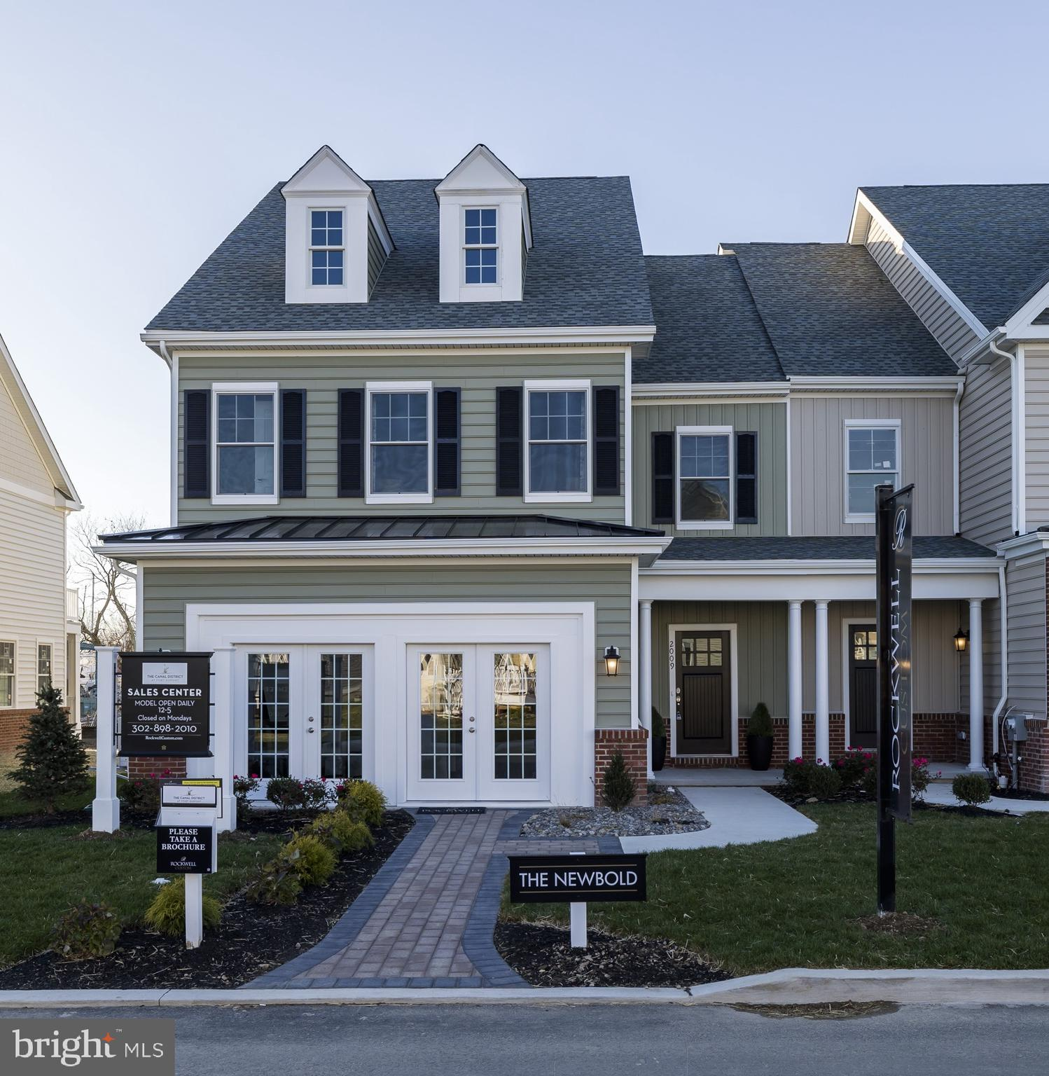 """Visit this home virtually: http://www.vht.com/434139415/IDXS - Overlooking the lovely Branch Canal right on the waterside, this brand new custom carriage-style townhome featuring double decks...is a unique opportunity in New Castle County. Located in The Canal District at Fort DuPont. This floor plan features an open concept on the main floor with 3 bedrooms upstairs and a total 2.5 baths. This home also features a 2-car garage. The impressive kitchen is well appointed with granite counter tops, 42"""" custom cabinets with trim and soft close hardware and a massive island perfect for entertaining. The owner's bedroom has serene views and spacious walk-in closet. The homes are close to downtown and community boat access for outdoor activities year round. With future shops to include a restaurant, Beer Garden, a Theater district along with an expanded Marina District... making Fort DuPont the new sought after Riverfront in Delaware and the lifestyle you have always craved. With Wilmington, Newark, Dover, Christiana and the southern beaches a short drive away, you will love being close to everything yet nestled in a quiet setting. This home is currently under construction/to be built. Photos are for marketing purposes only and are not of the actual house. Visit the Sales Center Tuesday-Sunday 12:00-5:00. Home can be shown with scheduled appointment as well. County, City, School taxes, property assessment value and Square Footage are approximate amounts. Homes to be built. Stop by the Sales Center for additional information and check out the builder incentives for this month!"""