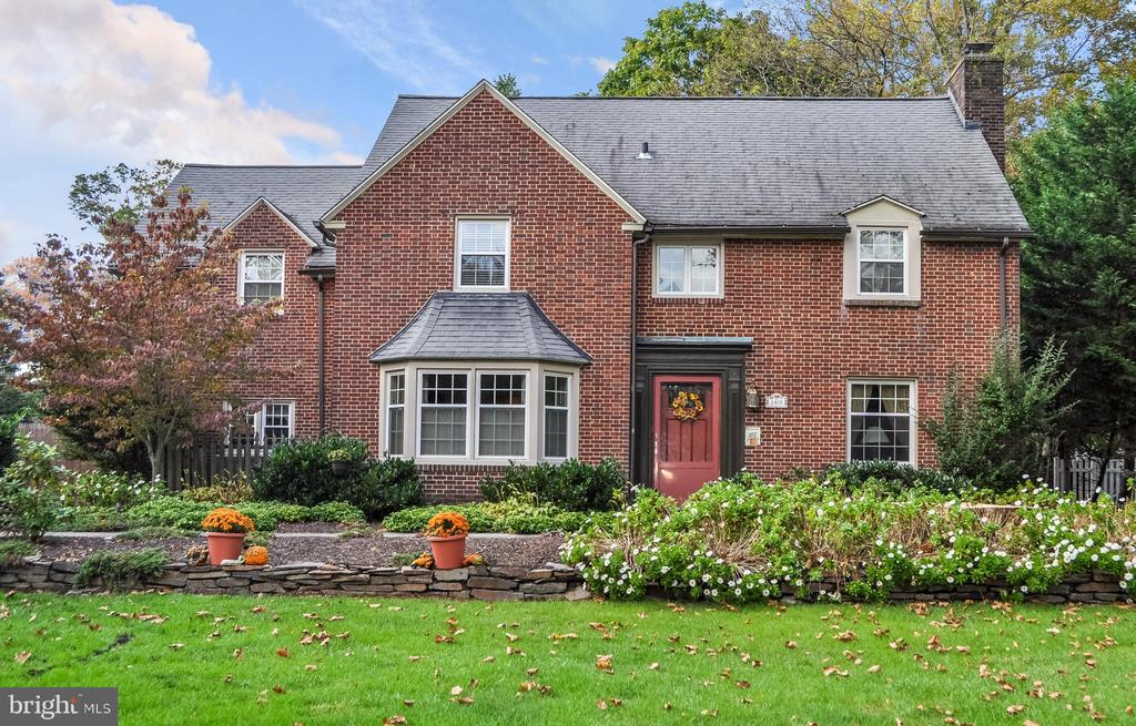 Fantastic opportunity to own this charming and spacious brick colonial in one of Wynnewood's most desirable neighborhoods! This 5 bed, 3 full/2 half bath home is situated on a beautiful tree-lined street close to parks, shopping, dining, library, and public transportation.  The first floor of this lovely home features hardwood floors and crown molding throughout. The center hall opens to a fireside living room and a formal dining room with chair rail and large bay window. At the end of the center hall sits an office/den with a bay window overlooking the backyard, built-in bookshelves, and a powder room. The center hall leads to an open-concept kitchen, eating area and large family room. The kitchen features granite countertops, Kraftmaid Cabinetry, tumbled marble backsplash, tile floors, and a gas stove. A large eating area opens up to a sunken family room with a raised, wood-burning fireplace, large bay window with window seat, and outdoor access to the flagstone patio. Outdoor entertainment space includes a large, landscaped, flagstone patio and level rear yard, which are easily accessible through doors from the kitchen, family room and living room.  The sun-filled second floor offers a master bedroom with a walk-in closet, 3 additional bedrooms, 2 full baths, and a hall linen closet. Third floor features a 5th bedroom or the perfect place for a private office where Zoom calls will not be interrupted, full bathroom, and storage room with cedar closet.  Fully-finished basement has a powder room and features an entertainment area with mini bar, as well as a workout area or game room. Laundry room with a pantry closet, utility sink, and room for an extra refrigerator/freezer completes the lower level.  Enjoy award-winning Lower Merion Schools and close proximity to South Ardmore Park, Penn Wynne Park, Penn Wynne Elementary, Penn Wynne Library, Wynnewood train station, shopping and dining at Suburban Square, Whole Foods, and Septa's Regional Rail Line and Amtrak servi