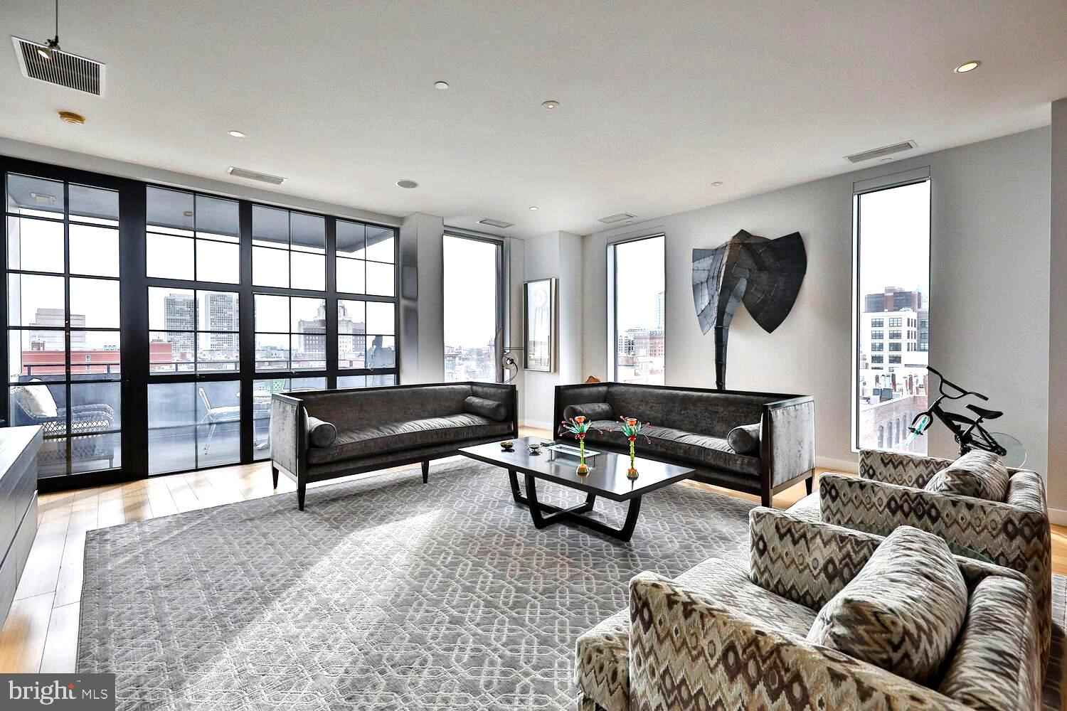"""This one of a kind, architecturally designed, 12-story modern masterpiece was built by renowned developers Brown-Hill.  Enjoy condo living in Old City, a quiet Historic neighborhood, where you can walk to theaters, the finest restaurants, galleries, and parks. This boutique building has a concierge staffed lobby. There are 2 elevators which open directly into this sunlit luxurious unit with stunning panoramic city, river, and bridge views! 10' ceilings, bamboo floors, floor to ceiling windows, a private balcony, an open Kitchen, Dining Room and Living Room, The Chef's Kitchen features a 36"""" Viking 6 burner gas range, Viking warming drawer, Viking refrigerator, two Fisher Paykel dishwashers, custom cabinets, honed granite countertops, pantry closet with a microwave, plus a breakfast bar for 3. A large Den/Bedroom with pocket doors consists of a custom Wet Bar, Viking wine refrigerator, plus incredible views. The Master Suite includes a custom platform bed with a built-in dresser with an abundance of drawers/shelves, and North, West & bridge and river views, plus, a huge custom walk-In closet. This sumptuous Master Bath Includes an oversized shower with massage jets, an oversized double-sink vanity with a stone countertop, Kohler & Grohe fixtures, a separate toilet closet, and a large linen closet. The second Bedroom En-Suite has views of the bridge as well. Other features include a large Foyer with a dramatic tray ceiling with up lights, a Powder Room with plaster stencil walls, a laundry room with a front-loading Whirlpool Washer & Dryer, a cedar closet, a large storage closet, 2 zone HVAC, custom blinds, built-In ceiling speakers, and best of all an assigned Covered PARKING Space!"""