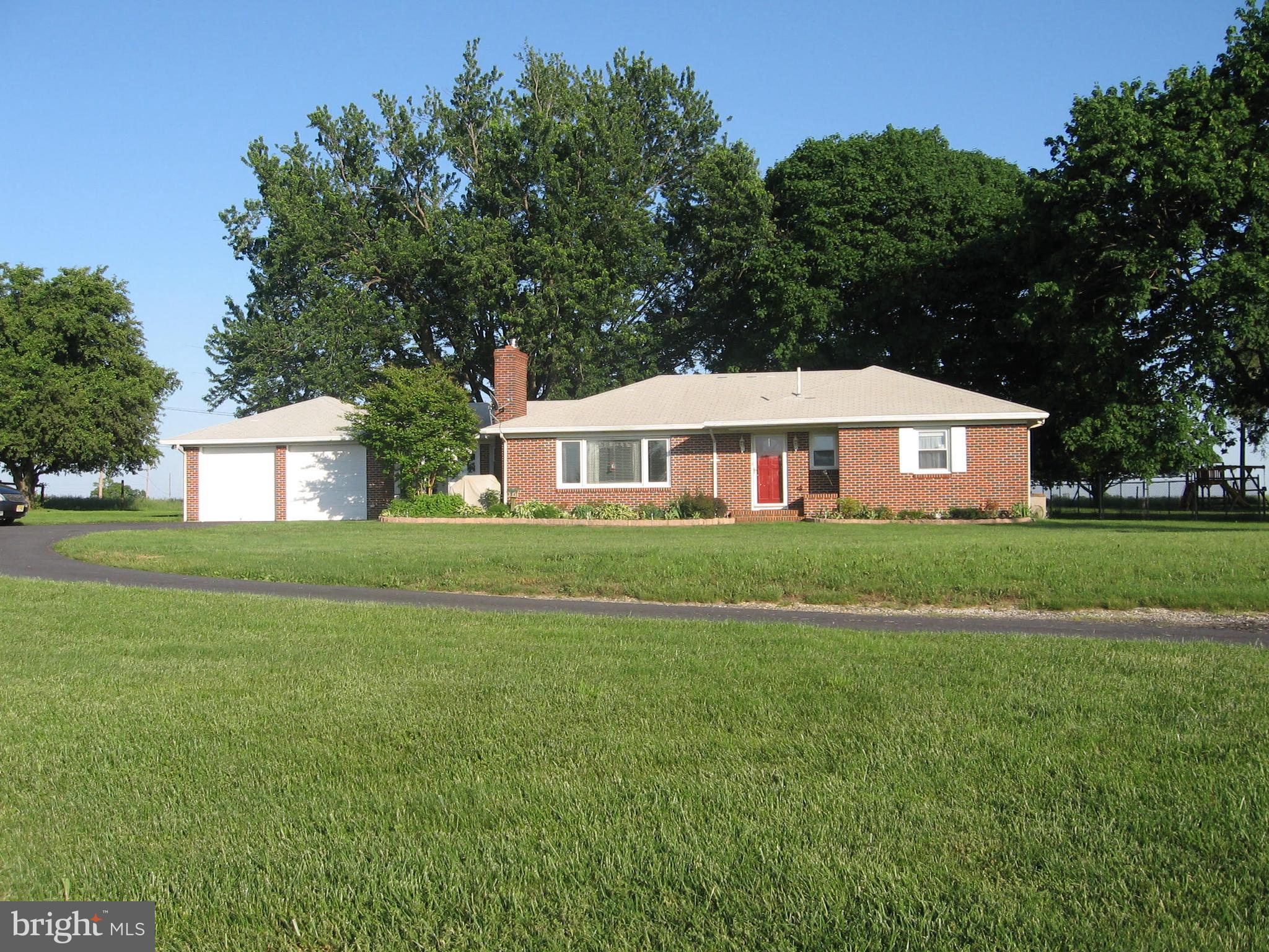 Very nice 3 bedroom brick rancher, 1.5 baths on approx 1 acre of land.  Enter into the spacious living room with a wood burning fireplace and opens to a cozy dining room.  Bright and cheery eat-in kitchen with tile flooring and includes all stainless steel appliances.  Laundry room is next to kitchen, washer & dryer are 3 years old and are included.  Furnace and hot water heater is 3 years old.  Walk thru and continue into the very large breezeway that goes out to the back yard or continue to the 2 car garage with pull down stairs to walk up attic.  Back yard is fenced and looks out to pastures.  Long driveway which widens up to the garage area.  Six month old roof with 50 year shingles and leaf guards.  Septic installed 5 years ago.  Must see!!  Welcome to the country!!