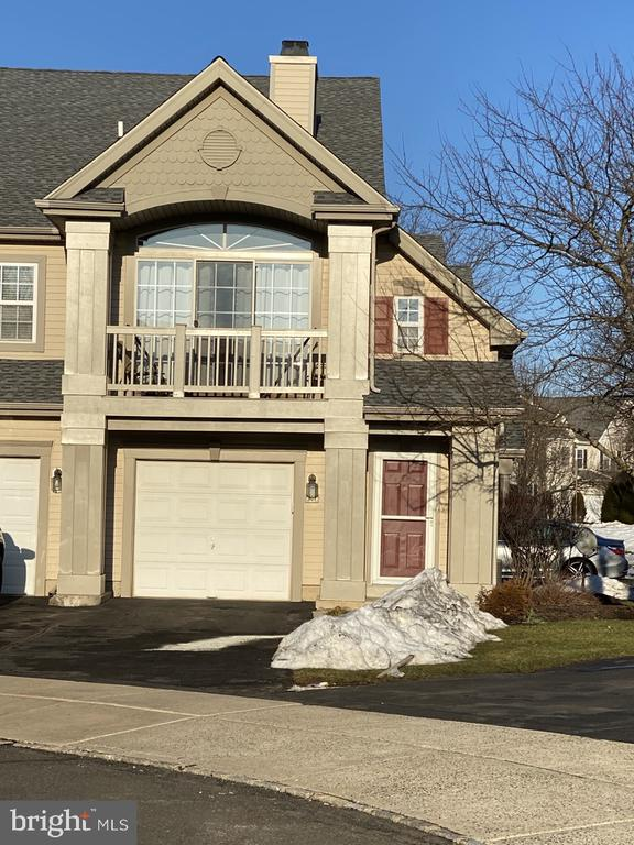 This one of a kind beautifully updated  2-bedroom end-unit condo in the sought-after COUNTRY CROSSING community is ready for May move-in. The cathedral ceiling living room offers an impressive gas fireplace with an architectural trim package, new marble surround, an above fireplace TV set up,  ceiling fan, coat closet, and a triple sliding door that opens to a balcony, great for morning coffee or just relaxing in the evening. A sound system is included for your listening enjoyment. The kitchen offers a gas stove, built-in microwave, newer dishwasher, 2-year old refrigerator, and opens to a view of the living room, dining room, entrance stairway, and balcony. A large master bedroom features a stunning new triple window with an architectural trim package, trimmed tray ceiling, a large walk-in master closet, ceiling fan, and last, but not least, a newly renovated master bath with floor-to-ceiling tile shower, new toilet, granite-topped double sink vanity, and linen closet. The large 2nd bedroom has 2 new windows, a new ceiling fan, a double door closet with plenty of storage space, and a sound system. The hall bath offers a double sink vanity and an additional closet. We saved the best for last. This unit features an oversized 1-car attached garage with a new automatic door opener that opens into the entrance hall foyer providing safety, easy access, and protection from the cold on those bitter cold winter days. A hallway includes another storage closet, a new HVAC, and a full-size washer /dryer for added convenience.  Other amenities and services include a new roof, Nest thermostat, neutral color paint, driveway parking plus an additional parking lot for guests. All open areas have classic chair rail moldings with wainscoting.   Lawn care and trash removal are provided by the Association. Conveniently located near major highways, train stations, dining, and shopping. Easy access to commuter routes, and 20 to 30 minutes to historic Doylestown and New Hope. Central Bucks School District. AVAILABLE FOR SHOWING on March 3. 2021. Only 2 prospective buyers are permitted in the unit at one time when accompanied by a licensed realtor. Masks must be worn at all times while in the unit.