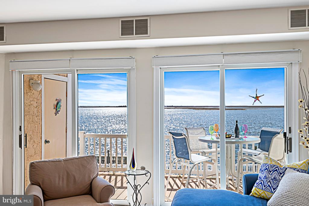 Now is the time to buy! This beautiful condo is ready to go and the furniture is included. The views are spectacular overlooking the Barnegat Bay and a glimpse of Old Barney (Barnegat Lighthouse)! Three balconies to relax and entertain on that are maintenance free. Comes with a boat slip with water and electric, docs for wave runners, a small beach, heated inground pool and a super large deck to enjoy all season long!  2 beds, 2 baths, kitchen with granite tops, wood cabinets, dining area, large family room with corner gas fireplace and wet bar. Double slider doors to the amazing deck overlooking the common decking area and docs to the bay! Blue skys as far as the eye can see! Second floor has a super large master suite, full bath with jetted tub, and stall shower. Double slider doors with views of the wildlife preserve. The second bedroom also has a deck to sit and enjoy morning coffee or a late evening beverage. The insurance includes flood and outside maintenance, there are 2 assigned tandem parking spots under the unit. It will not last long, so make your appointment now!