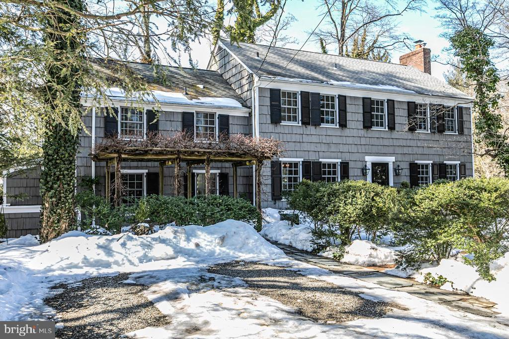 This graceful, relaxed Princeton home is sure to please with its big, fenced backyard, its stylish family and mudroom, and rooms that have all the coziness and charm of 1950's architecture. From the rich built-ins and paneling in the fireside living room and the dining room to the year-round heated enclosed porch that extends the dinner party, there's so much to love. The cheerful kitchen has plenty of space to work and dine in. The family room is adjacent with a gas fireplace and a second set of stairs that lead past a gorgeous bank of windows to the home office, guest bedroom, and full bathroom - one of three on the second floor. The main bedroom has its own private bathroom and there is another in the hall near the other two bedrooms. Storage is generous throughout including extra closets in the hallway and a large storage room in the partially finished basement. A Dutch door in the mudroom is another appealing touch, opening to an organized area that keeps the recycling out of view and a brick walk that extends around to the front and back. It's an easy stroll from here into the heart of Princeton and to the University for all the offerings of this vibrant town!