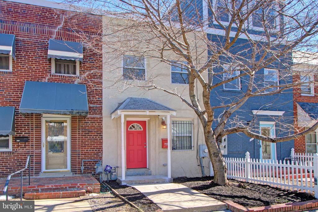 From the cherry tree in the front yard to the expansive patio out back, the yard will get you on this one! This beautiful Federal townhome has been freshly painted throughout and showcases wood floors, central heat and cooling, new carpet upstairs, new granite kitchen counters, recessed lighting, a built-in laundry on the upper level, a storage shed, and covered off street parking with electric garage door.  This home is located within walking distance to Stadium Armory metro station.  The interior has been virtually staged to show this home's potential.