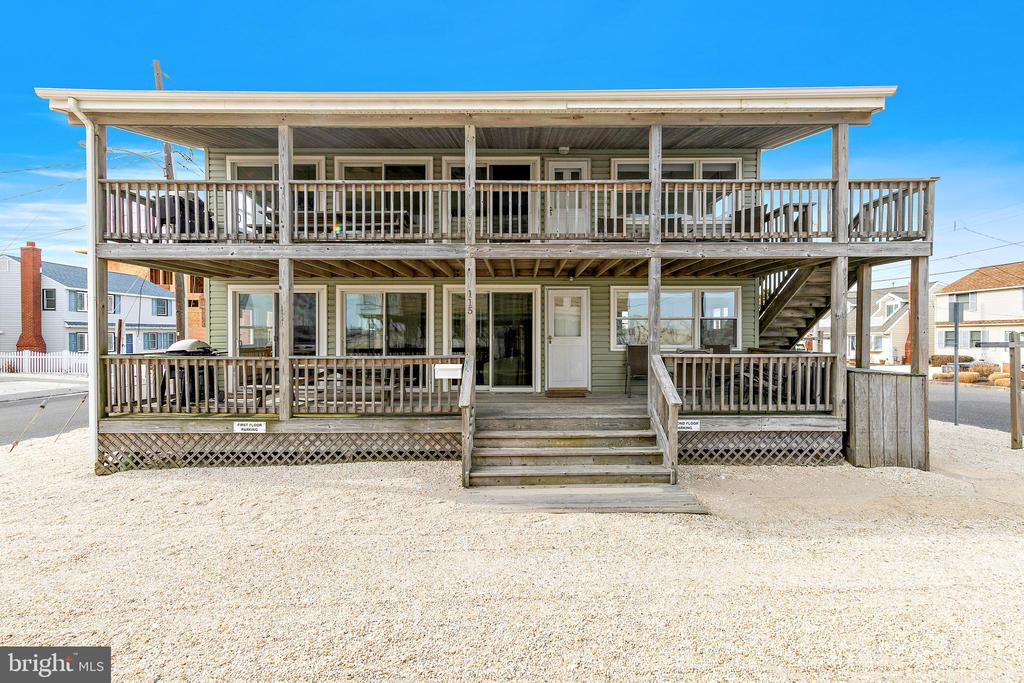 Ocean Block Duplex 3rd from the Beach with views!  Each unit has 3 Bedrooms, 1 Bath and has been updated over the years.  Large Decks provide Ocean breezes and plenty of room for dining and relaxing, while the three sets of sliders let in lots of natural light.  Efficient ductless units in both main living areas provide A/C and supplemental heat.  Bathroom makeovers are almost complete. The current owner has enjoyed the flexibility of renting/using this property for the past 50 years. Owning a duplex is a great way to enjoy Long Beach Island.  Use one unit, rent one unit or share with family or friends. Walking distance to the Acme and restaurants. Check this one out and start making your LBI memories!