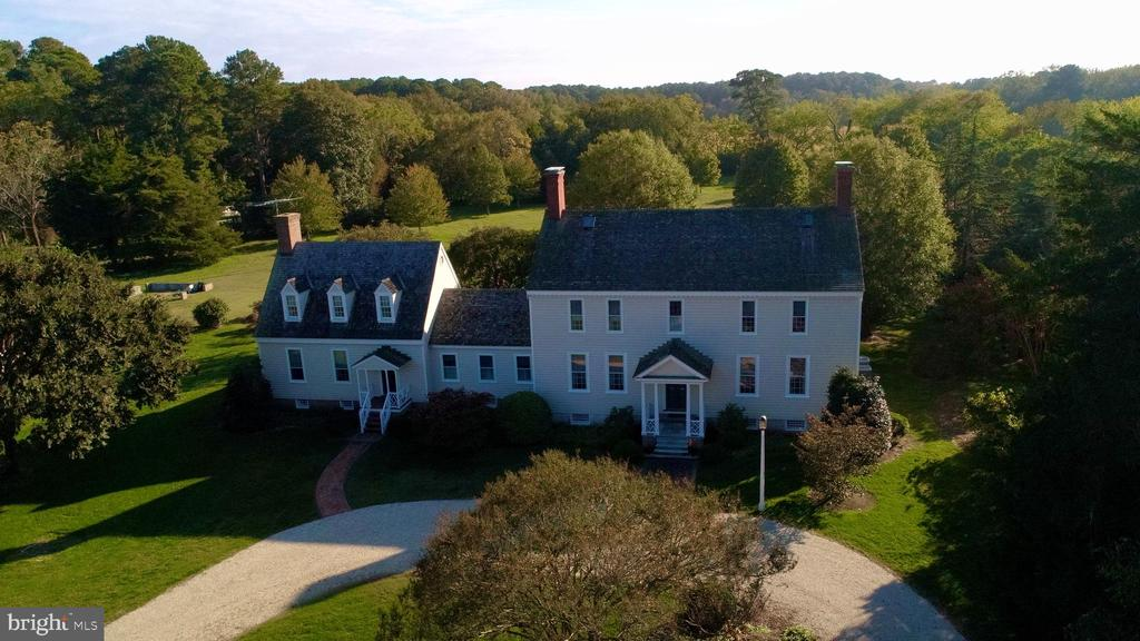 WOODLANDS is a beautifully restored 1760s colonial house located on 293 acres in Northampton County. This historic home has 4 bedrooms, 3 full and 2 half baths, a chef's kitchen, and a sunroom overlooking the back patio gardens. Fine details include original millwork, heart pine floors, and 5 brick fireplaces. Property has access to deep water on the Machipongo River which flows into the Atlantic Ocean. Under conservation easement.