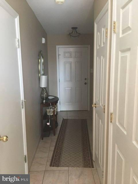 Welcome home to this spacious end unit townhome that backs to a large wooded lot. Upgrades throughout. There is a 1 car garage, patio pavers that surround the home and backyard.  Great, large windows and natural light throughout the home. The living room has beautiful hardwood floors and cathedral ceilings.  Large eat-in kitchen has plenty of storage and counterspace. The kitchen also has a sliding door with access to the 2nd floor deck.  Upstairs has  3 generous sized bedrooms. The main bedroom is complete with it's own private bath.  There is a walk out basement that affords additional living space for entertaining with a gas fireplace and a full bathroom. New hot water heater installed 2020. The community has tennis courts and the location is easy access to route 55.