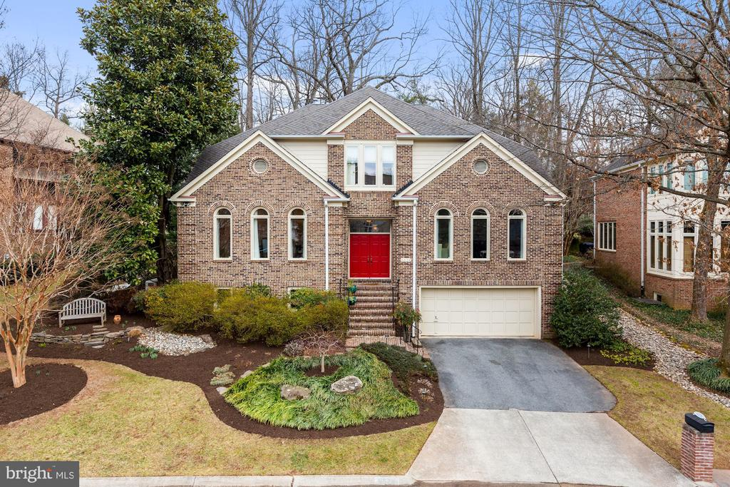 No detail has been overlooked in this Bethesda home, from sophisticated finishes to a spacious open floor plan. The main level features high ceilings, a stunning foyer opening to a bright living room and elegant dining room. A gourmet kitchen, sun-lit breakfast area that opens to the family room overlooks the landscaped rear yard. An oversized study and powder room complete this level. Upstairs is a gracious master suite with dressing room and updated bath, as well as three additional bedrooms and two full baths. In the lower level there are two bedrooms/home office space, a full bath, family room with fireplace, abundant storage and access to two car garage. Truly a showstopper!
