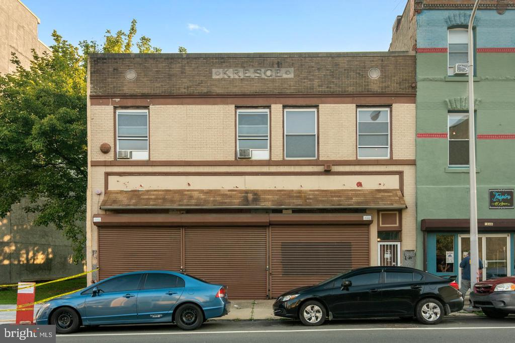 Business and Development opportunity in the Francisville area!  This unique property is CMX 2.5-- mixed use.   The Bottom level of this building is currently being used to store cars, basement area fully cleaned out.  There is a fully renovated and beautiful apartment on the 2nd level of this  property.  It features 3 generous sized bedrooms with beautiful finishes. The living room has a wood burning fireplace, very large eat-in kitchen with tons of storage space.  This property is 40x100 with access to the back street.  Located in the Heart of Francisville with tons of creative and beautiful new construction.  take advantage of the 10 year tax abatement on this property; The possibilities are endless here - if you want to open a business, it's ready!  if you want to redevelop it's ready!   Drive by the area and see what's happening here.   Make your offer today.