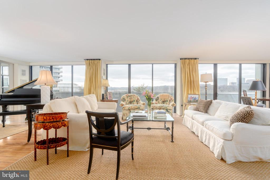 Rarely available,  corner unit with unobstructed views from every room of the Potomac River from Georgetown to the Memorial Bridge including the city of Arlington  skyline!  2+Bedrooms/2.5 Baths (currently shown as a large one bedroom) with over 2660 SF.  Balcony and new floor-to-ceiling  sliding door windows along the entire perimeter of the apartment to step out from each room.  Luxuriously large foyer perfect for art.  Expansive Living Room includes wall of built-in bookshelves and wet bar.  Additional sitting area perfect for an art gallery and room for a baby grand piano.  The Dining Room sits affording views out of a corner wall of windows,  perfect for viewing sunsets and the waterfront activity.  A library/office/den including a gas fireplace is off the Chefs kitchen.   The bright and spacious kitchen includes top of the line appliances, a pantry  and a washer/dryer.  The Master suite with large closets is off the sitting room.  Excellent storage throughout plus an additional designated basement storage unit.  Floor plans included within  the photo gallery.  Contiguous apartment #806, fully renovated 1400 SF is also available for sale.