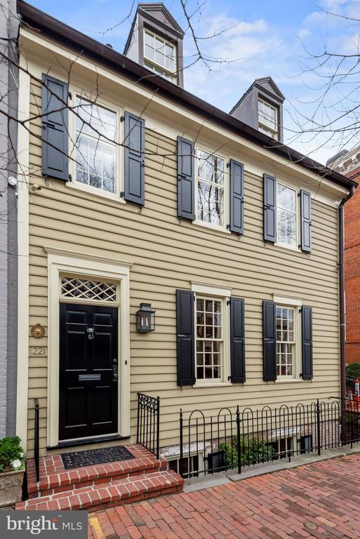 Originally constructed circa 1800 and restored to maintain its Federal  integrity, this jewel of Georgetown presents historical ambiance while accommodating today's modern lifestyle.  Built originally by Henry Foxall, a protege of Thomas Jefferson, this handsome property is an exceptional example of an early 19th century frame dwelling and is one of the few surviving of its type in Georgetown.  Four finished levels boasts , three full  bedrooms, three full bathrooms,  one half-bath, Waterworks finishes, top-of-the-line appliances, original pine floors and a beautifully manicured garden.  Ideally located  in Georgetown's East Village , only a half-block from M Street.  It offers easy access to shopping and fine dining establishments along Georgetown's main thoroughfare, within a block of Rose Park and close proximity to Foggy Bottom Metro.  Seller will provide Garage Parking immediately adjacent to the property for one year.