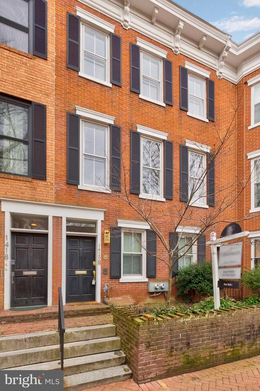 Experience city living at its finest from one of DC's most sought-after streets. Welcome to 1420 Corcoran Street NW, a 4-bed, 3.5-bath row home spanning 3 levels that strikes just the right balance between elegance and comfort.  Steeped in natural light and defined by stylish touches found throughout, no detail has been spared in the home's meticulous design. Each of the three expansive bedrooms are made for unwinding after a long day, with the Primary Suite featuring a working wood-burning fireplace, custom closets, and a chic ensuite bath. Host a socially-distanced soiree from the comfort of your sizable patio, or look out from your private balcony to take in scenic city views. This home also comes with two private dedicated parking spaces right behind the garden. Complete with a legal separate above-ground 1-bed, 1-bath unit, this home includes a turnkey rental opportunity—with parking—that's too tempting to pass up. Set on an idyllic, tree-lined street in the popular Logan Circle neighborhood, residents here will find themselves at the center of a vibrant community that has something for everyone. Just a stone's throw away from the attractions of 14th Street and a short drive to the cultural destinations of Downtown DC, Logan Circle is no doubt the place to be.