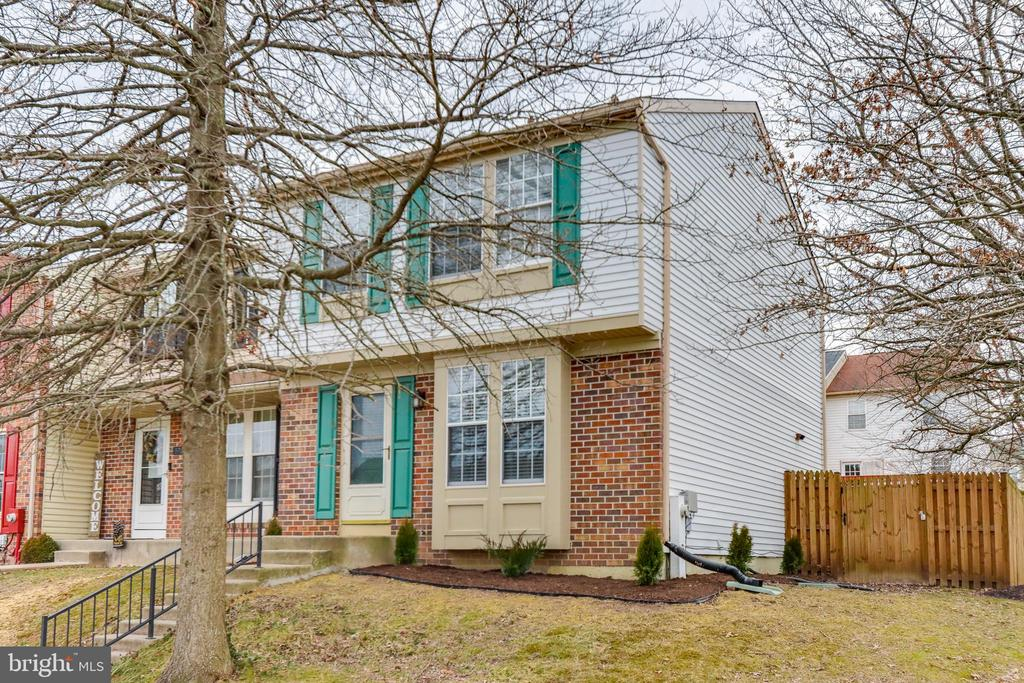 Welcome to this beautiful (Move-In-Ready) Brick Front END OF GROUP Townhome in desirable Ridgely's Choice!!! The Main Level features a Light-Filled Open Layout with Wood Laminate Floors, a Large Family Room, and a Pass-Through Window to an Eat-In Kitchen with Stainless Steel Appliances and Neutral Cabinets/Countertops. The kitchen slider leads to a Large Fenced Yard that is perfect for entertaining. Outdoor Shed offers extra storage. Upper Level features 3 Bedrooms with Vaulted Ceilings, Skylights, and Renovated Full Bathroom. The Fully Finished Lower Level offers a Large Recreation Room with Cozy Wood Burning Fireplace. Perry Hall schools. An extremely convenient location offers easy access to many shopping, dining, entertainment options, and just minutes to major commuter routes. Make your appointment now!!!