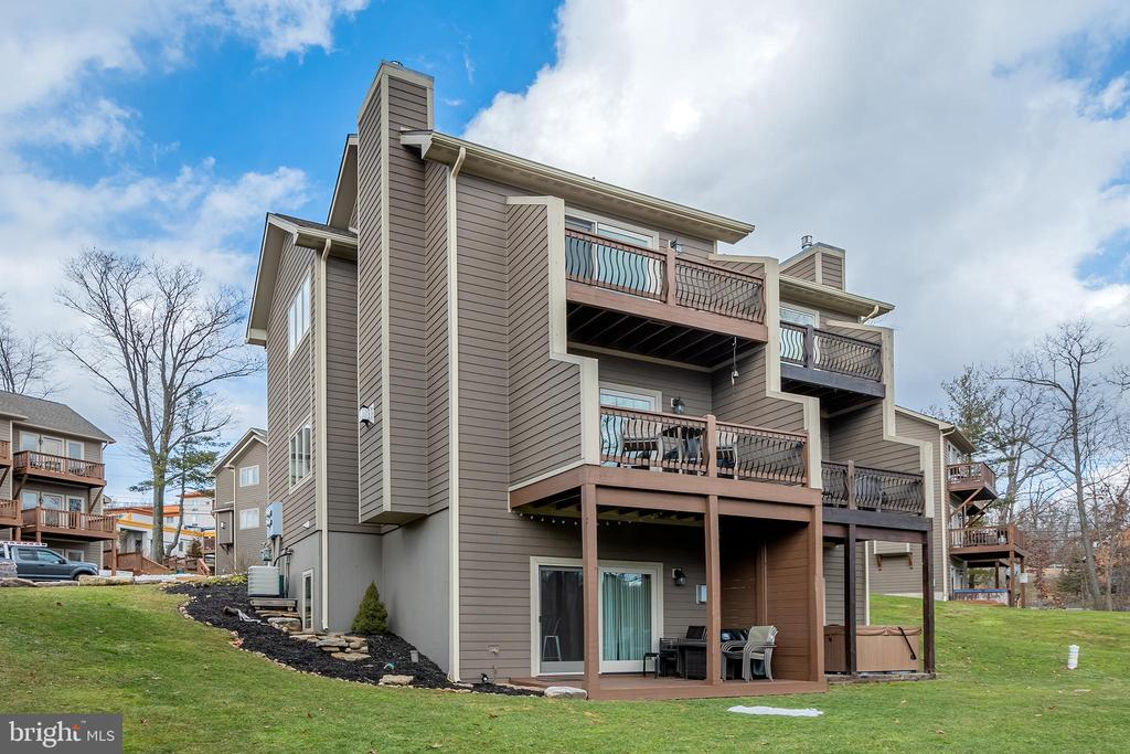 Perfect Location! This new 3BR/3.5 condo is conveniently located within minutes of Wisp Resort and Deep Creek Lake. This unit is an open floor plan, offering hardwood flooring, granite countertops,  stainless steel appliances, fully furnished, custom made bar in basement.  A stone fireplace, and plenty of space for entertaining guests. Take in the wooded views from the large deck or relax on the balcony off of the master suite while watching the ski slopes!